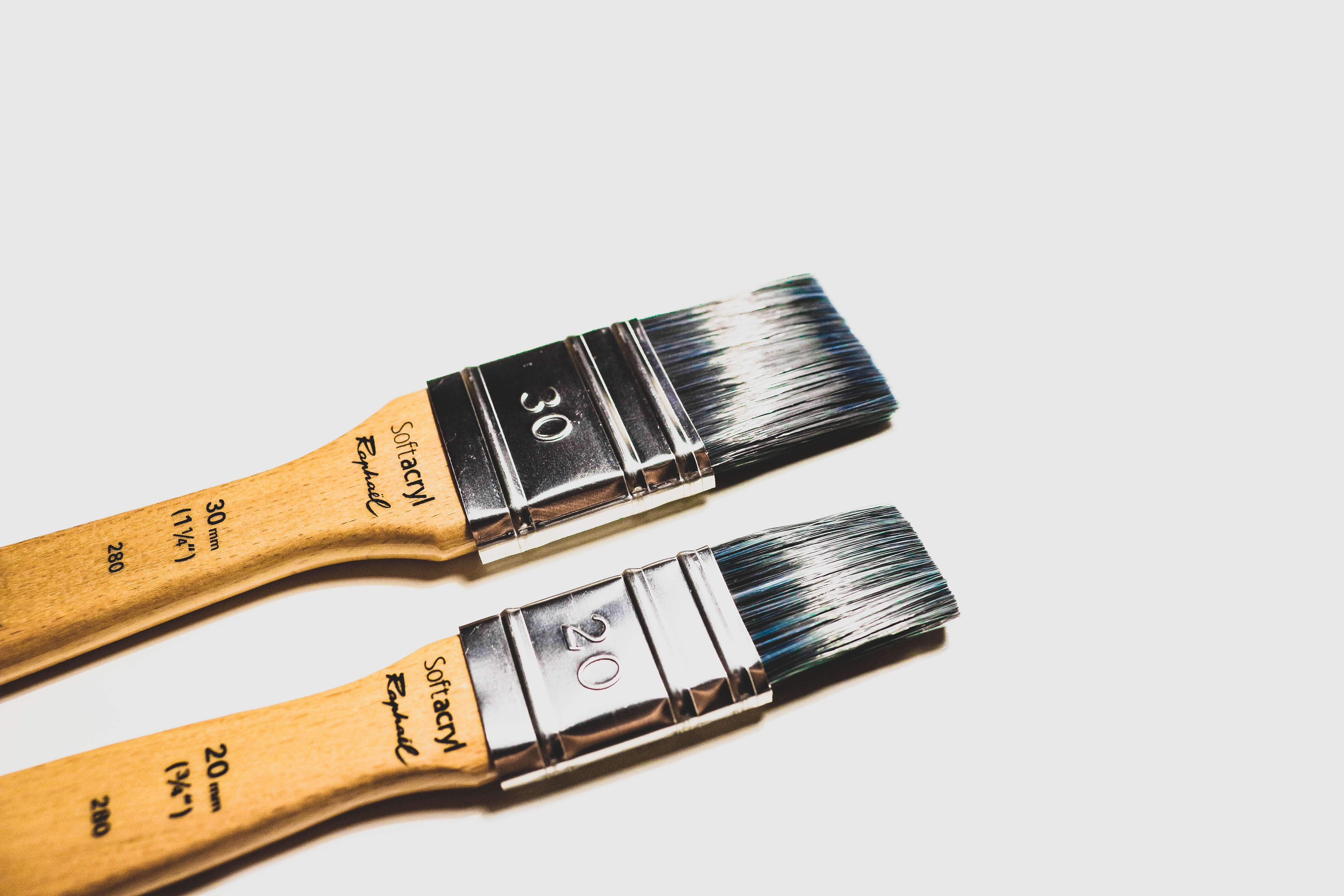 two brown paint brushes