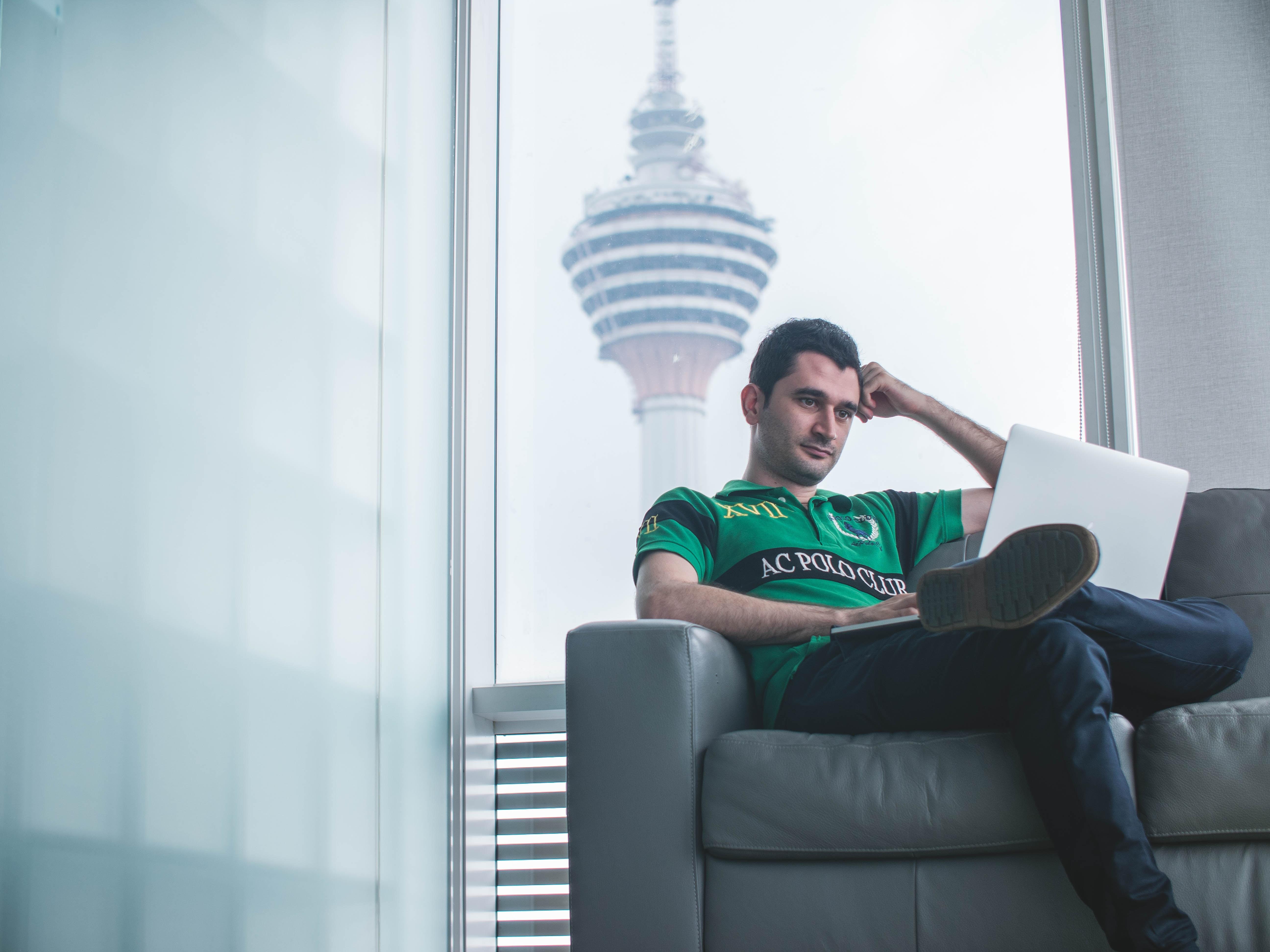 man watching on laptop