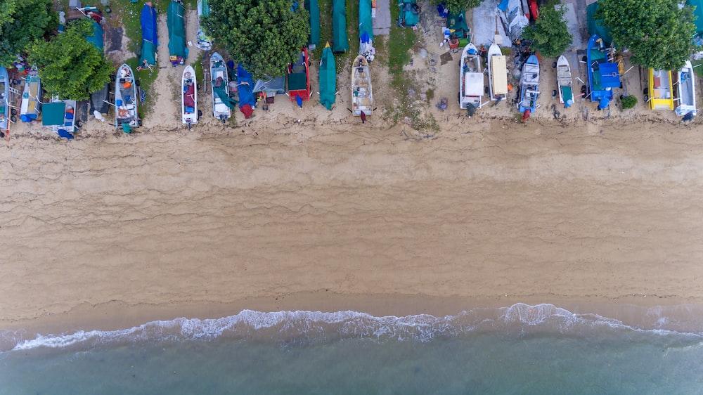 assorted-color bots beside seashore