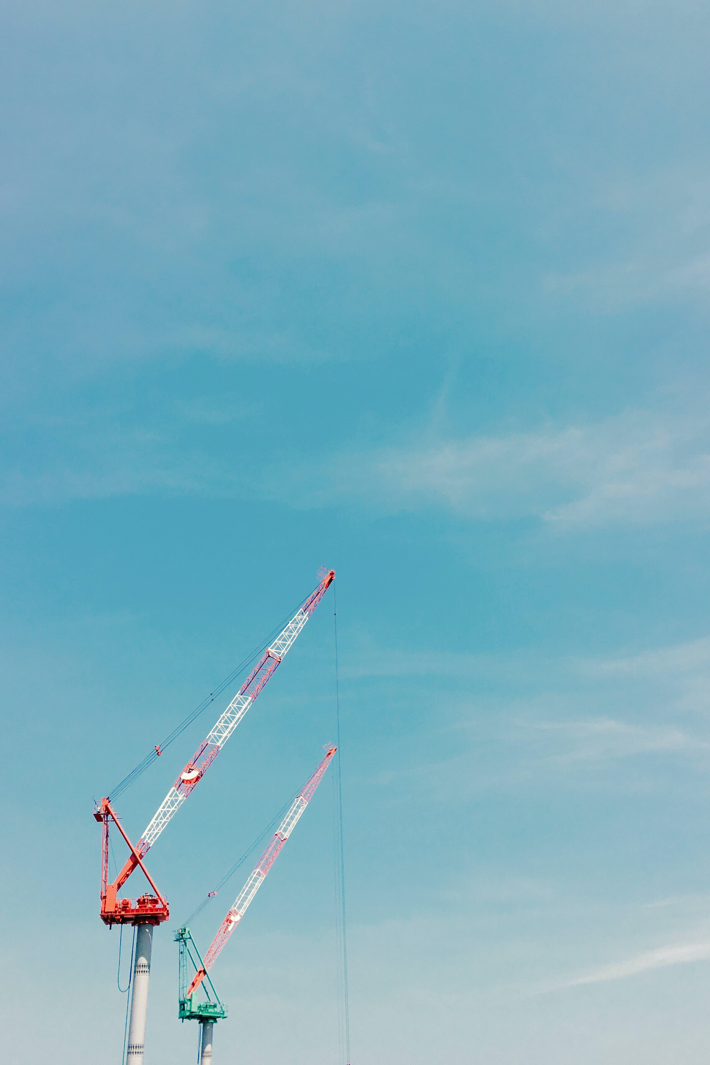 red and green steel cranes during daytime