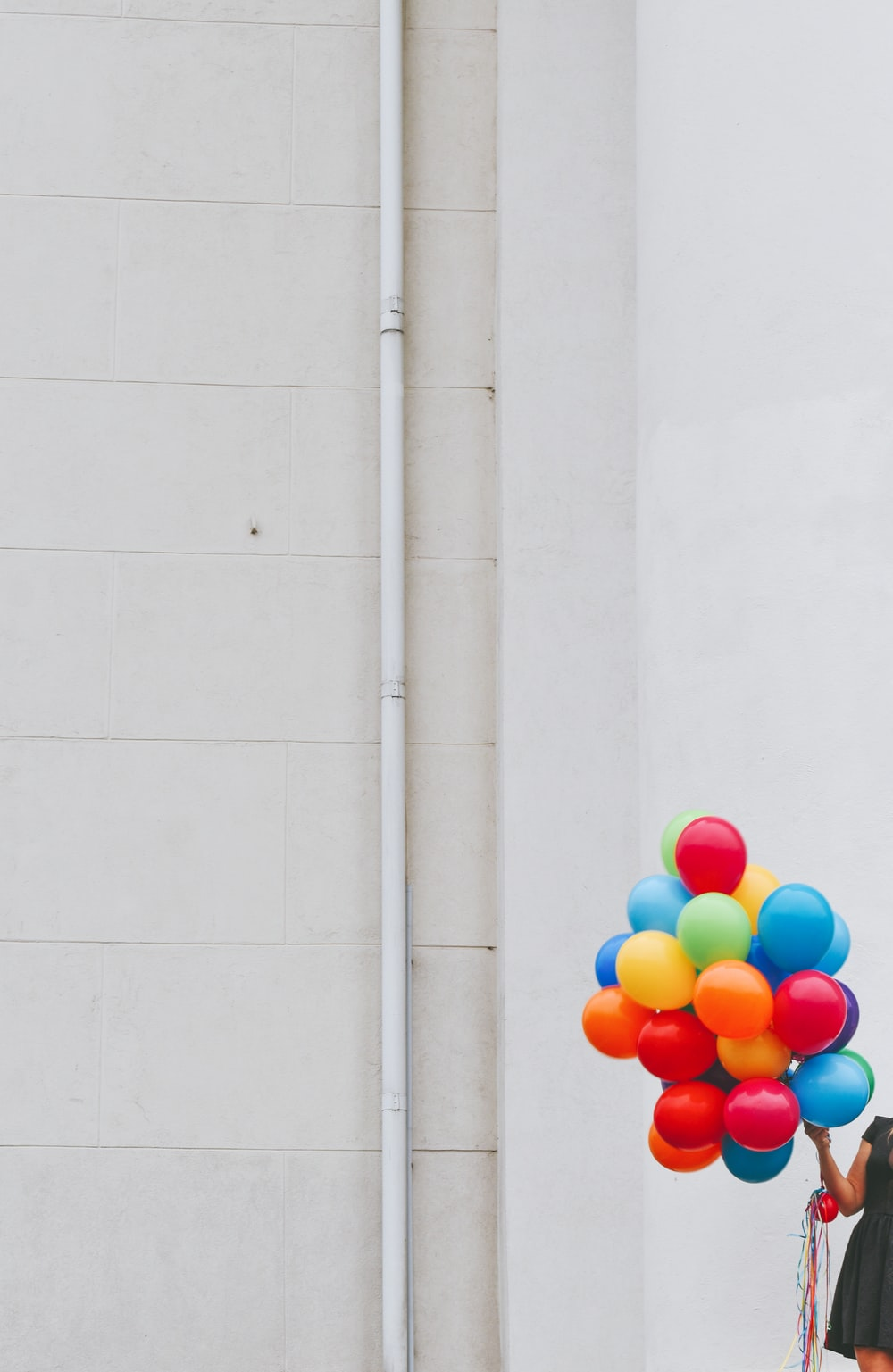 woman holding balloons