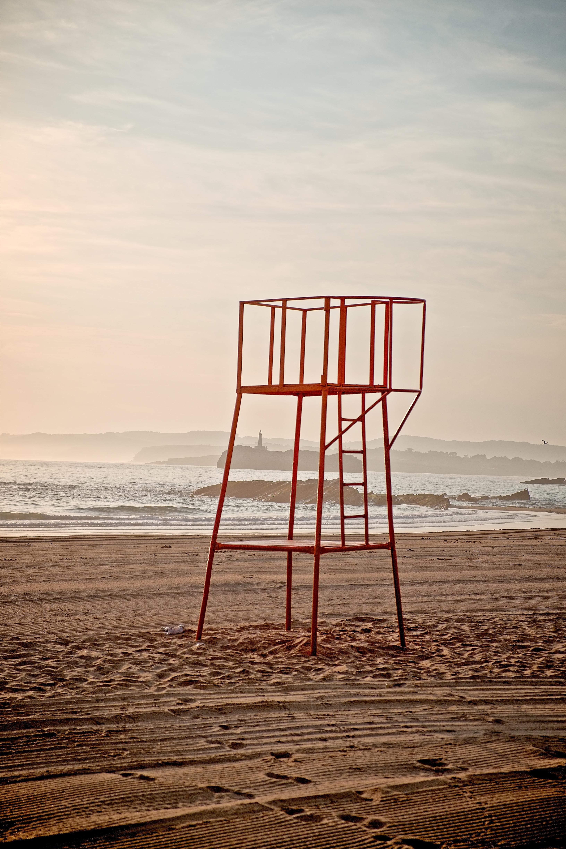 red metal lifeguard platform