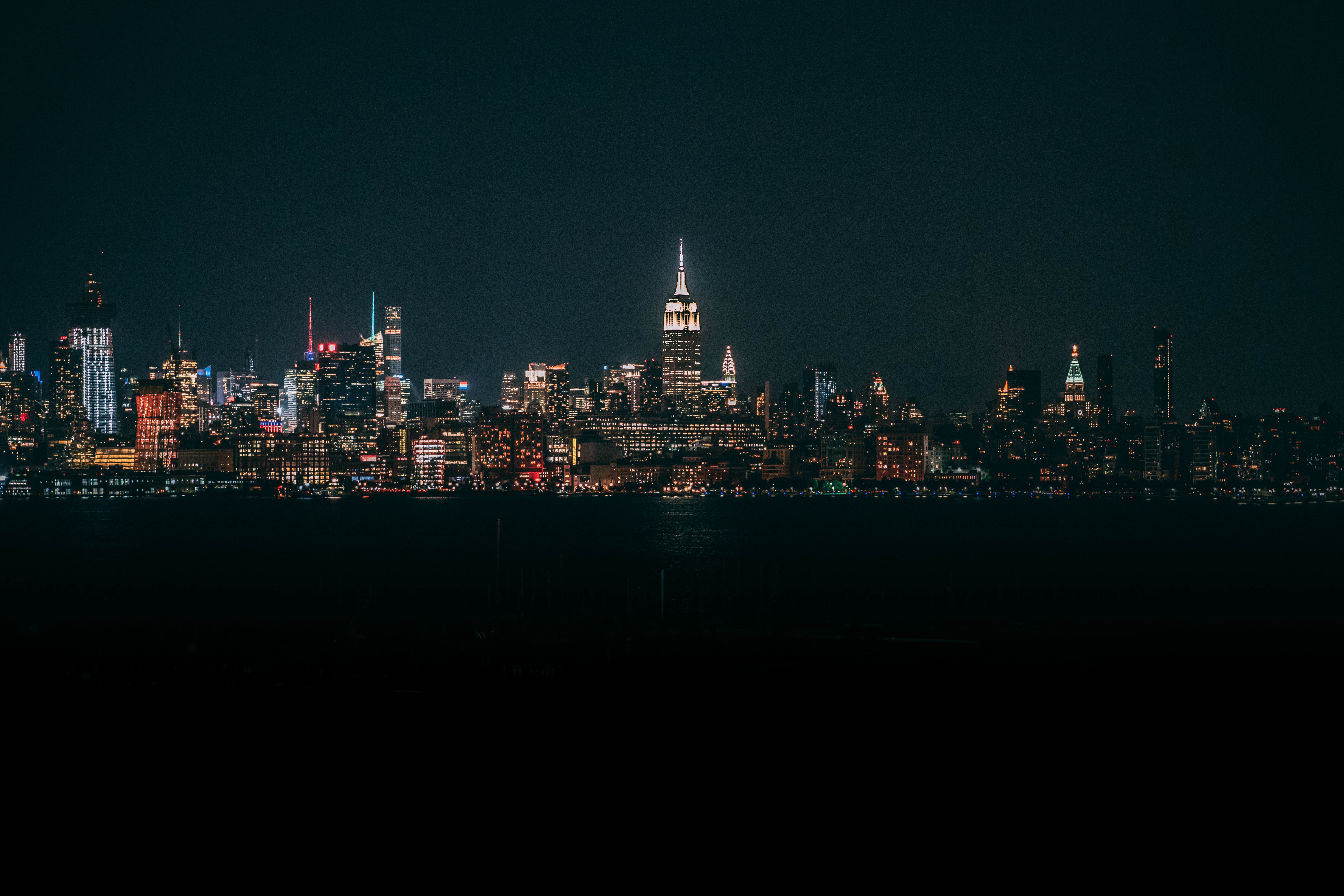 cityscape near bodies of water at night time