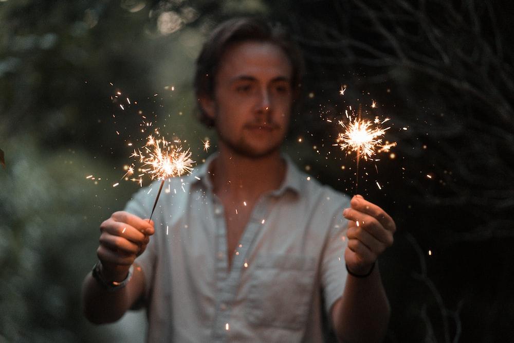 man holding sparklers