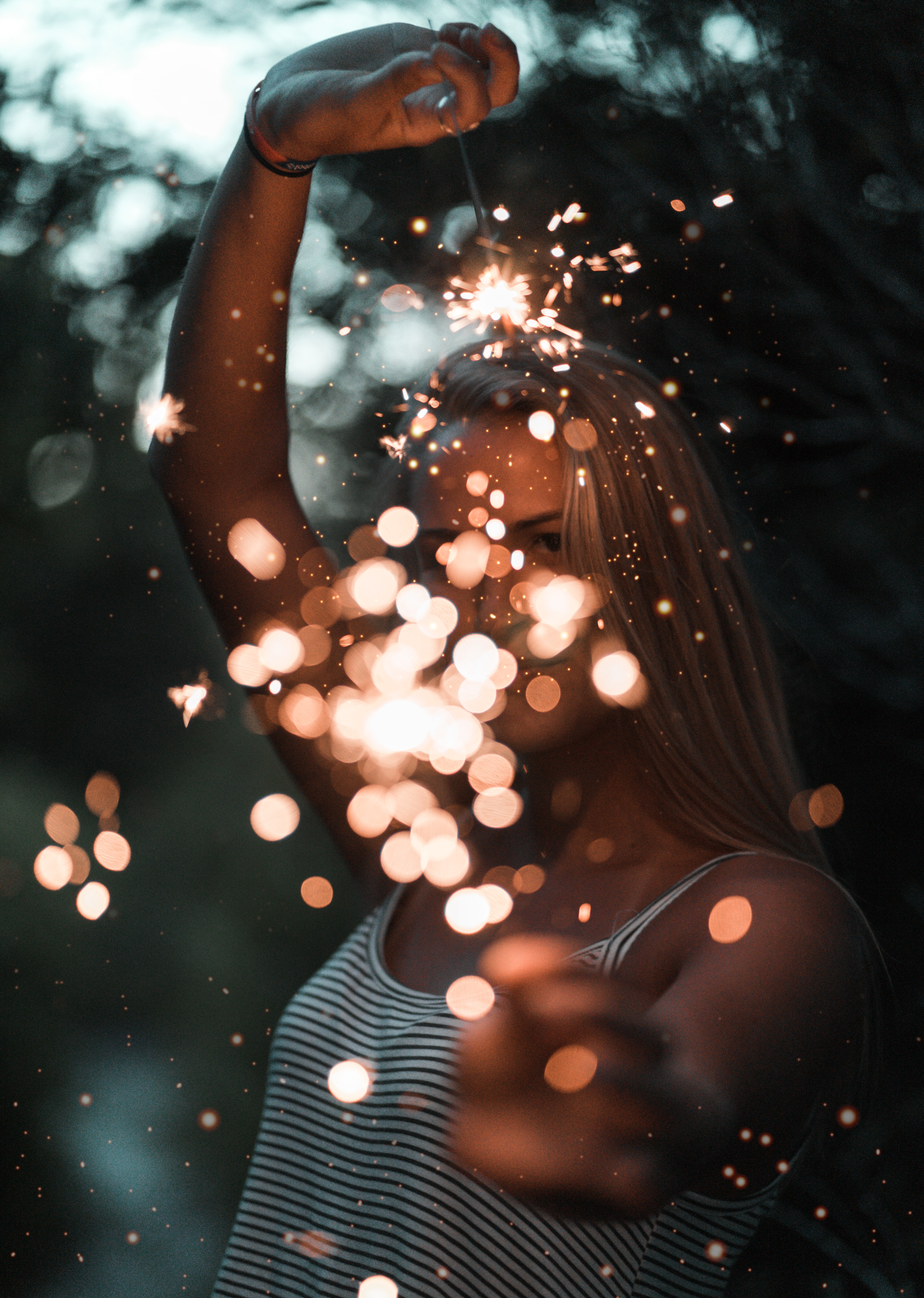 woman holding sparklers bokeh photography