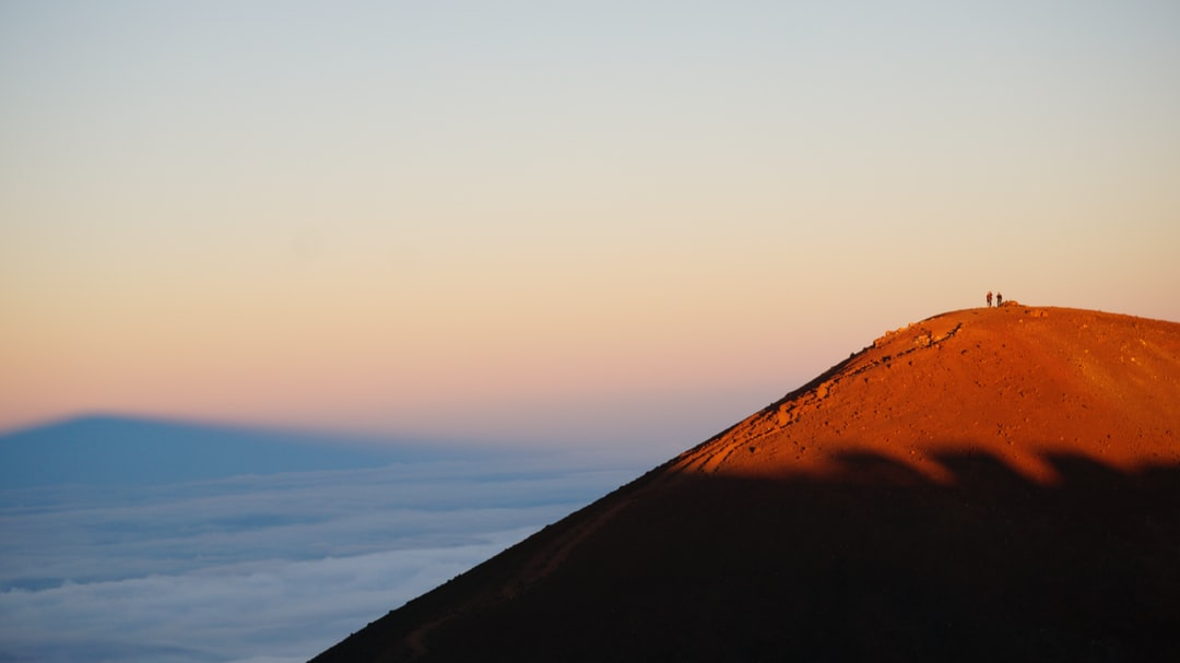 We took a sunset and star gazing tour to the top of Mauna Kea on the Big Island of Hawaii. The light was beautiful and for a few minutes we could see the shadow of the mountain on the clouds below. You can also see the shadows of the nearby observatory domes on the mountainside.