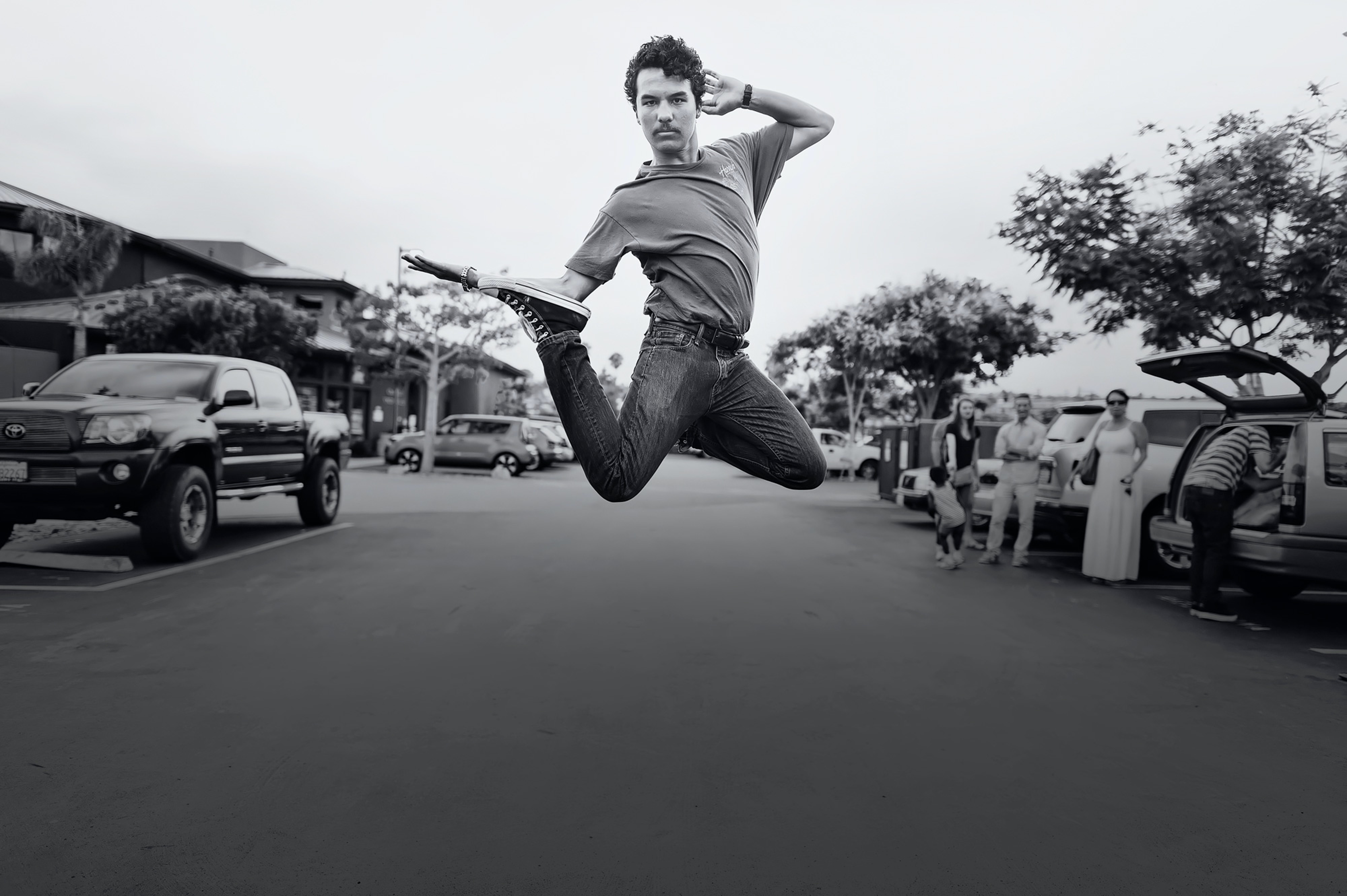 grayscale jumping photo of man