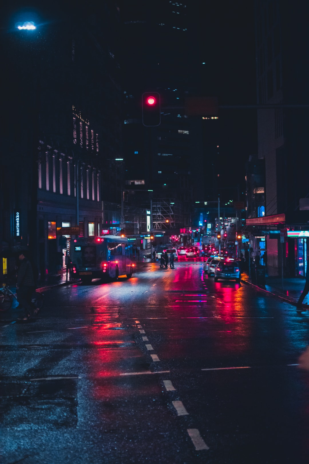 I was on my way to vivid when it started raining and as I crossed this street I noticed how it has its own vibe with all the lights and reflection from the wet asphalt.