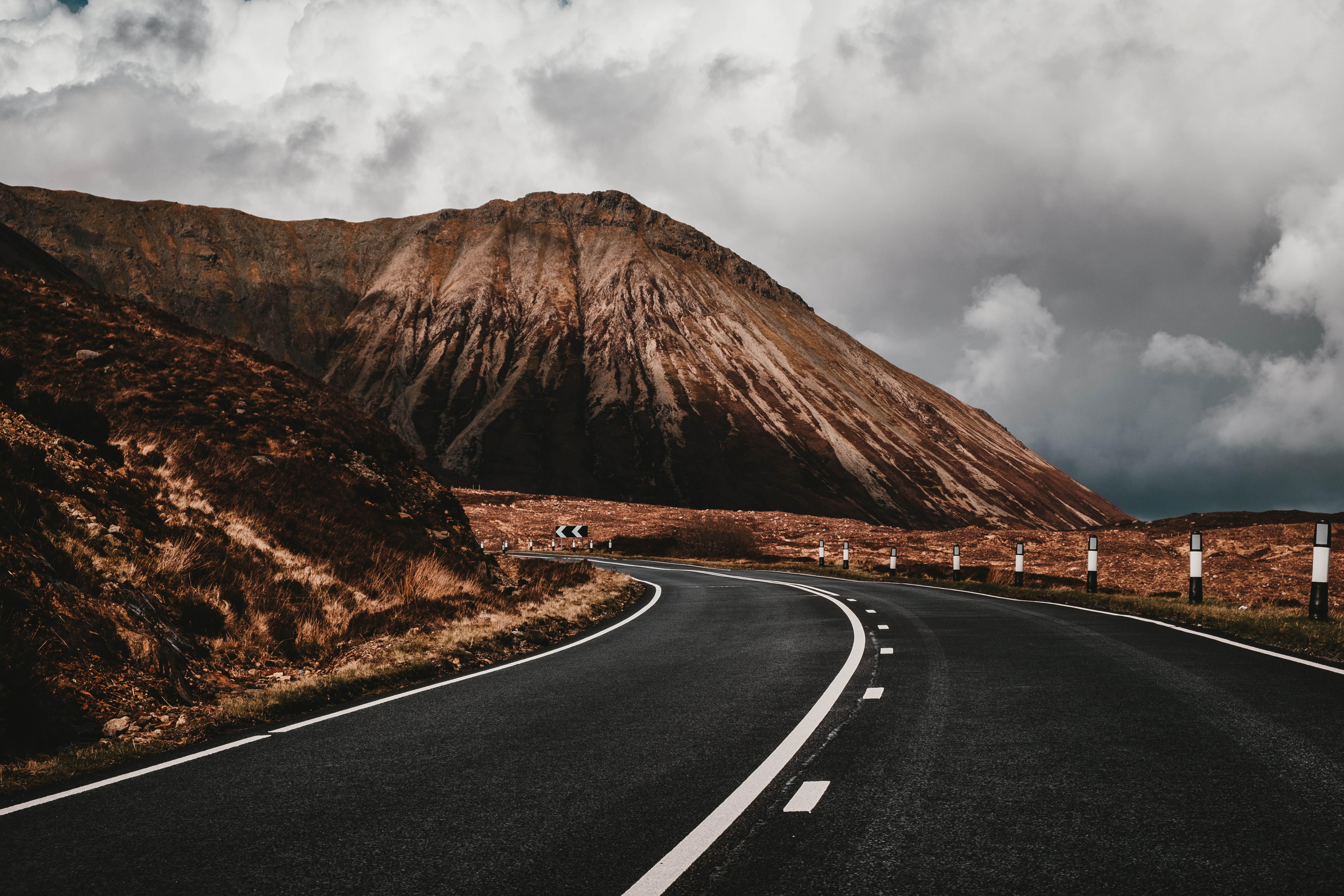 asphalt road near mountain