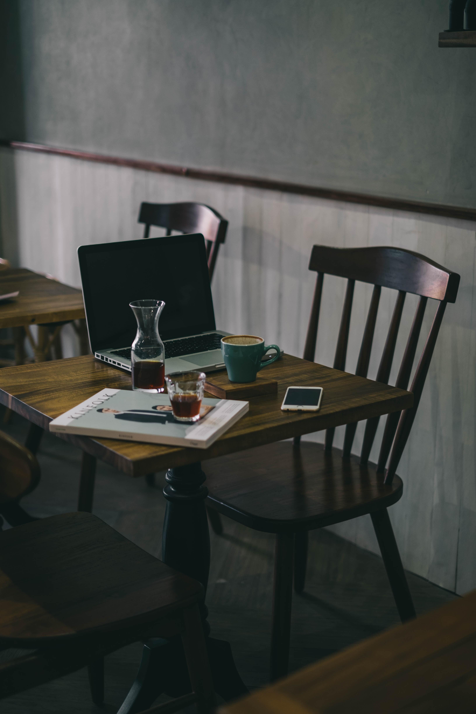 teal ceramic mug on brown wooden table