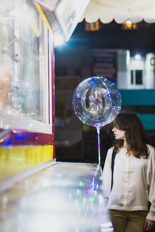 woman standing near crystal decor