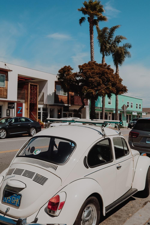 Volkswagen Beetle park beside sidewalk