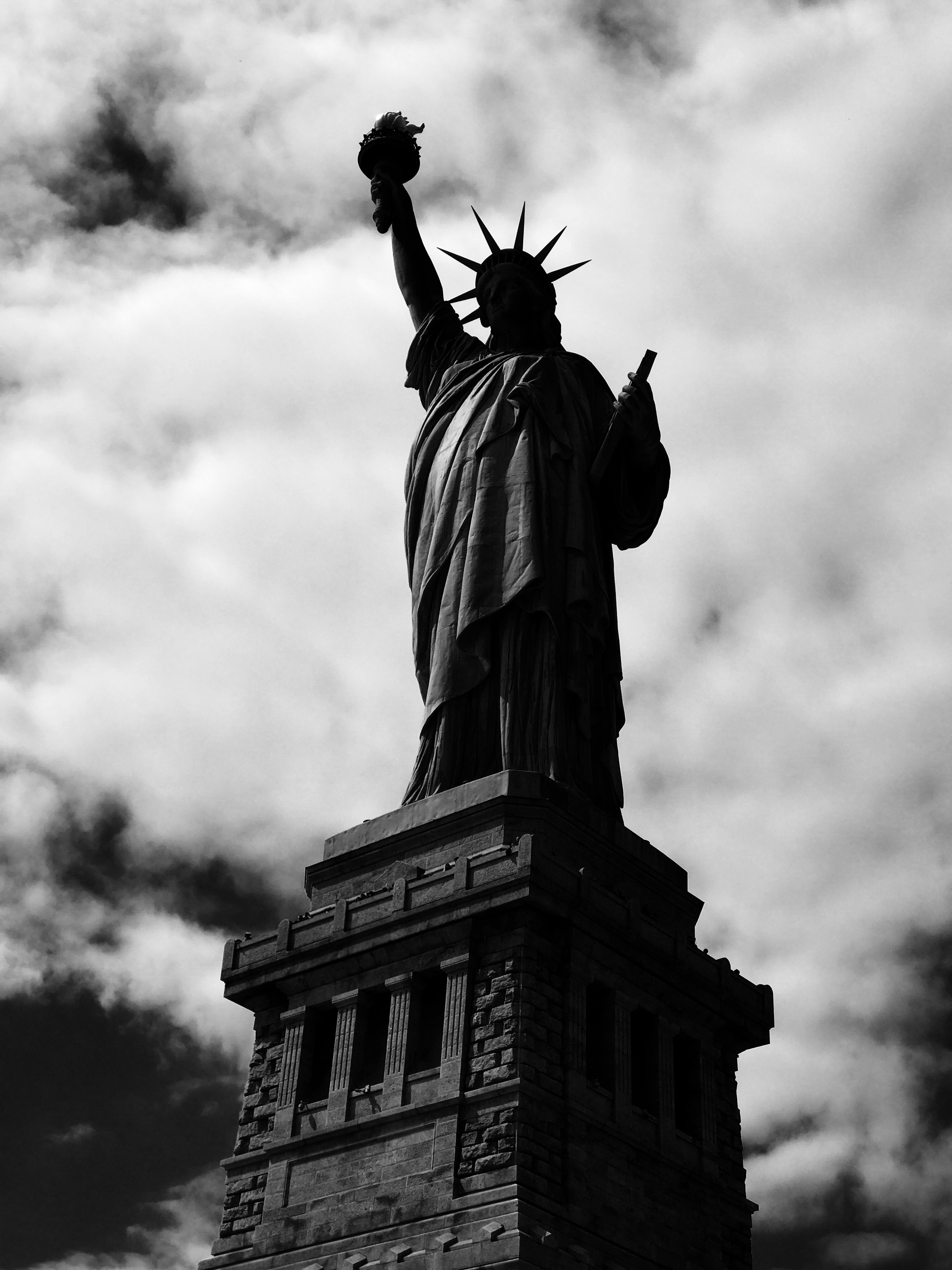 low-angle grayscale photo of Statue of Liberty