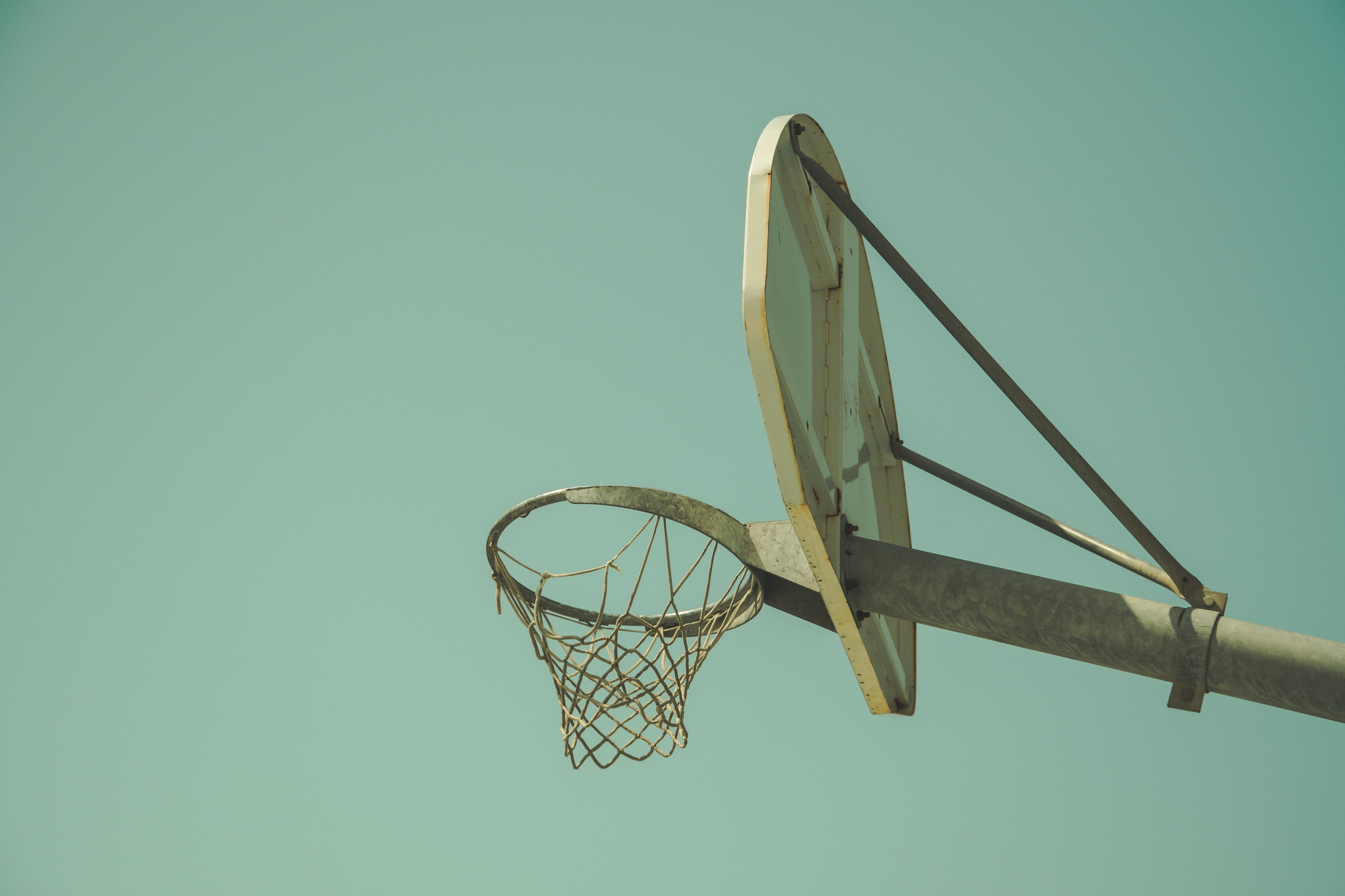 low angled photography of beige basketball hoop