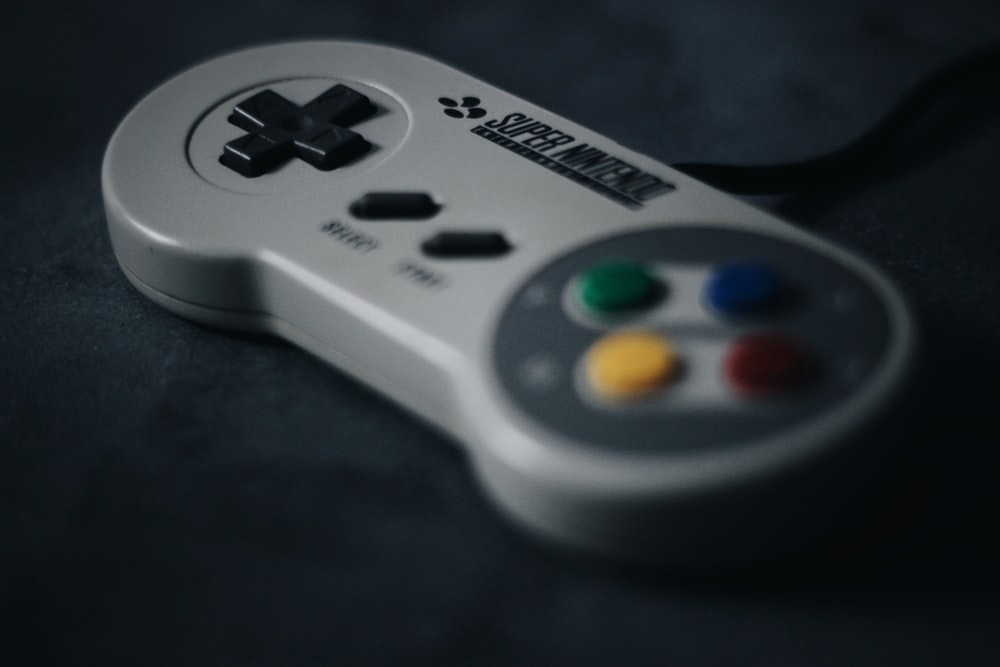 SNES controller on black surface