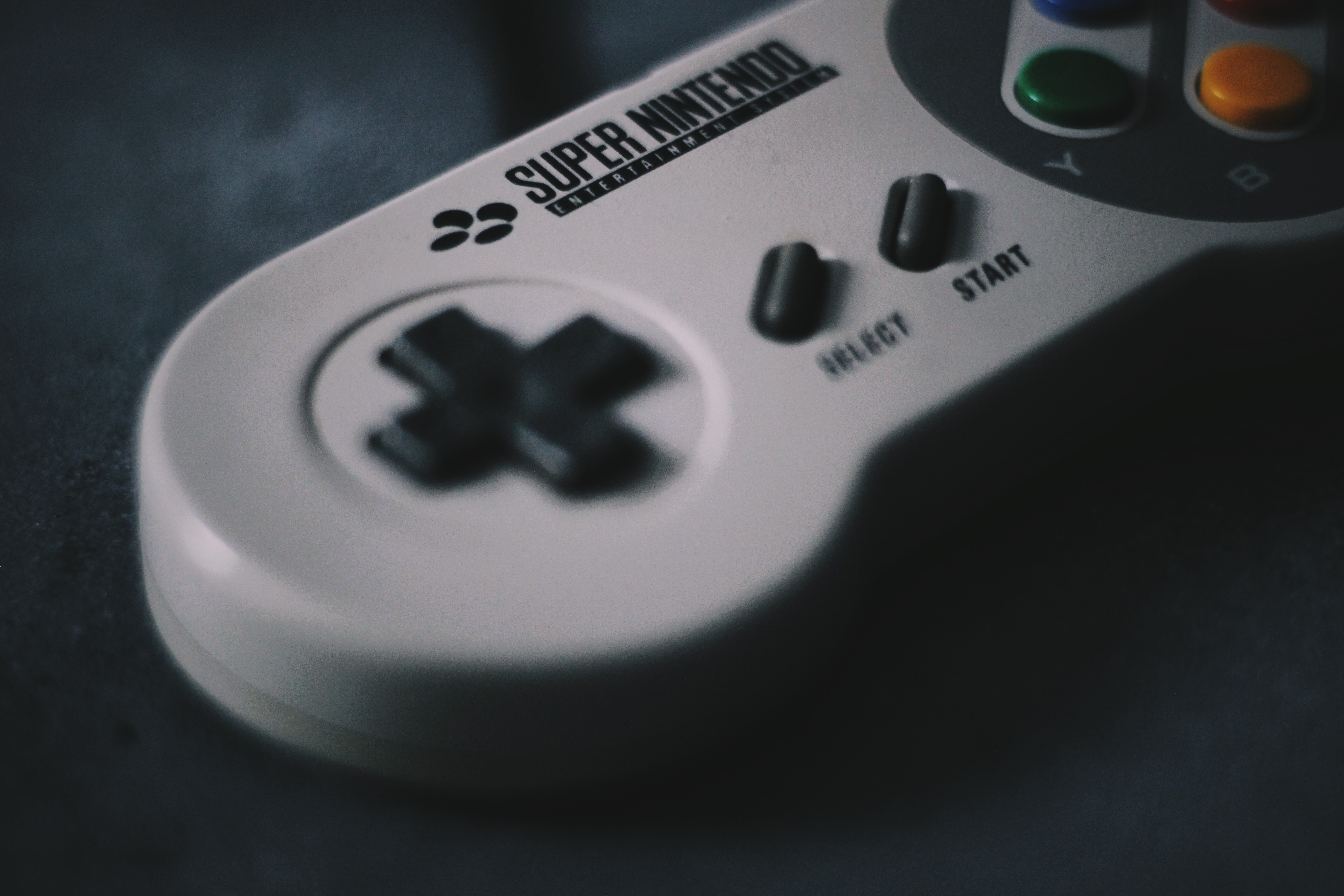 selective focus photography of SNES controller