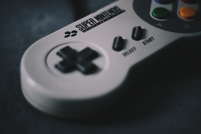 selective focus photography of snes controller super bowl teams background