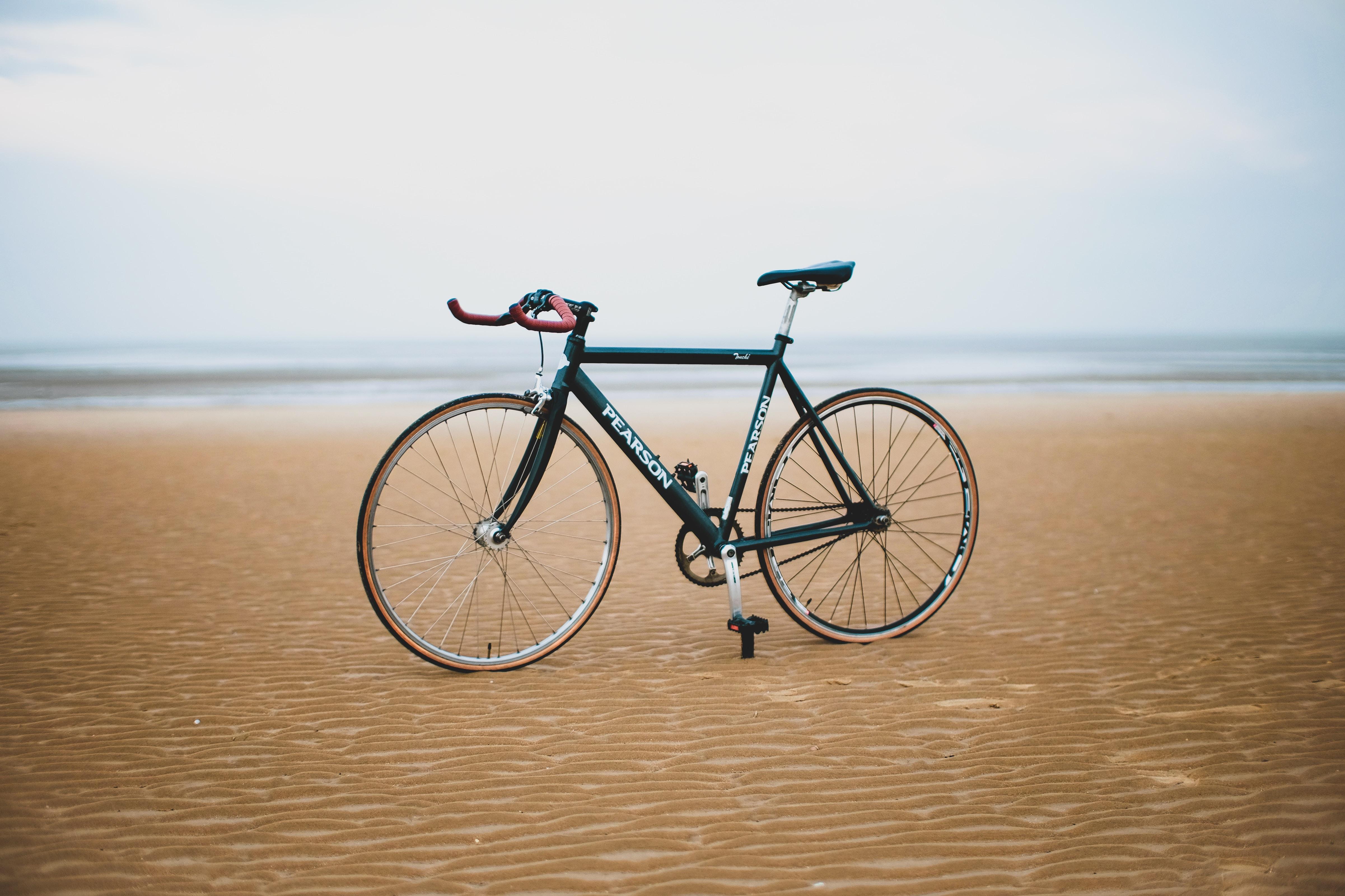 black road bike on sand