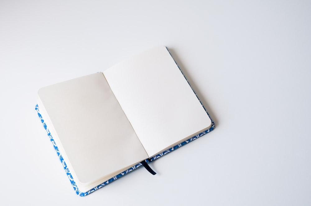 opened book on white platform