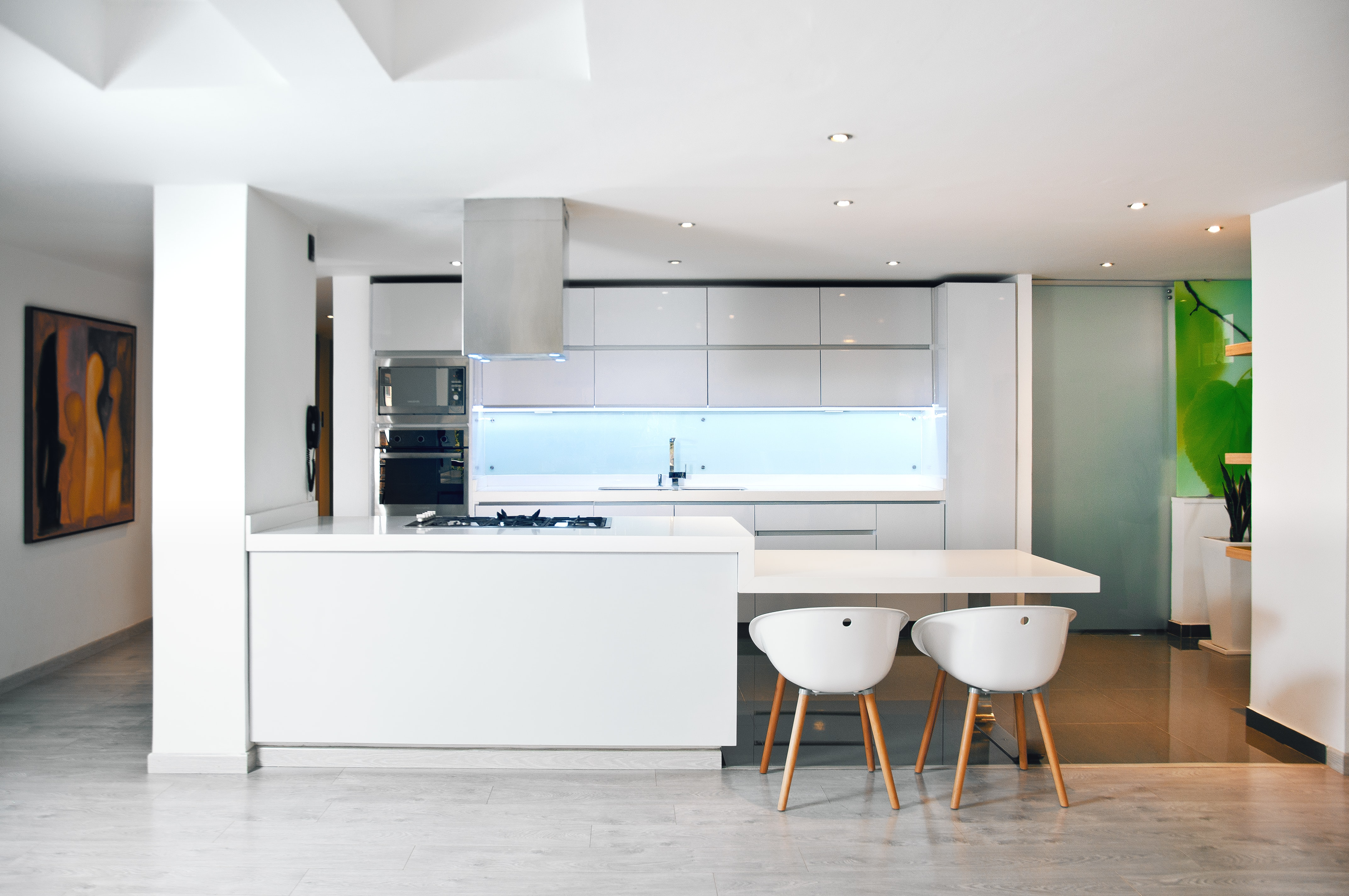 white wooden table and chairs on gray flooring
