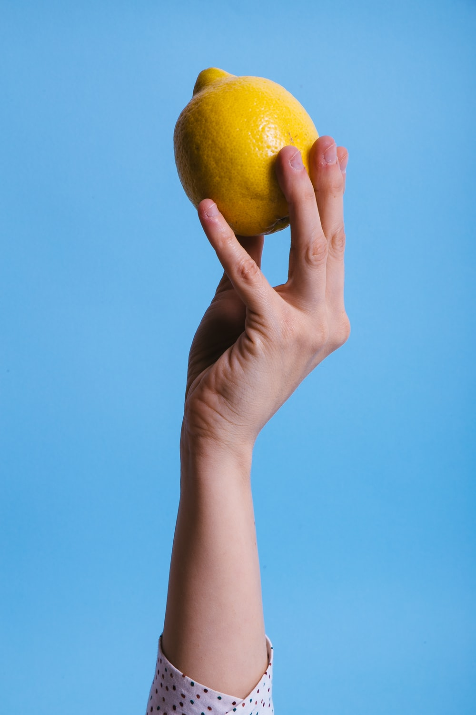 person holding lemon