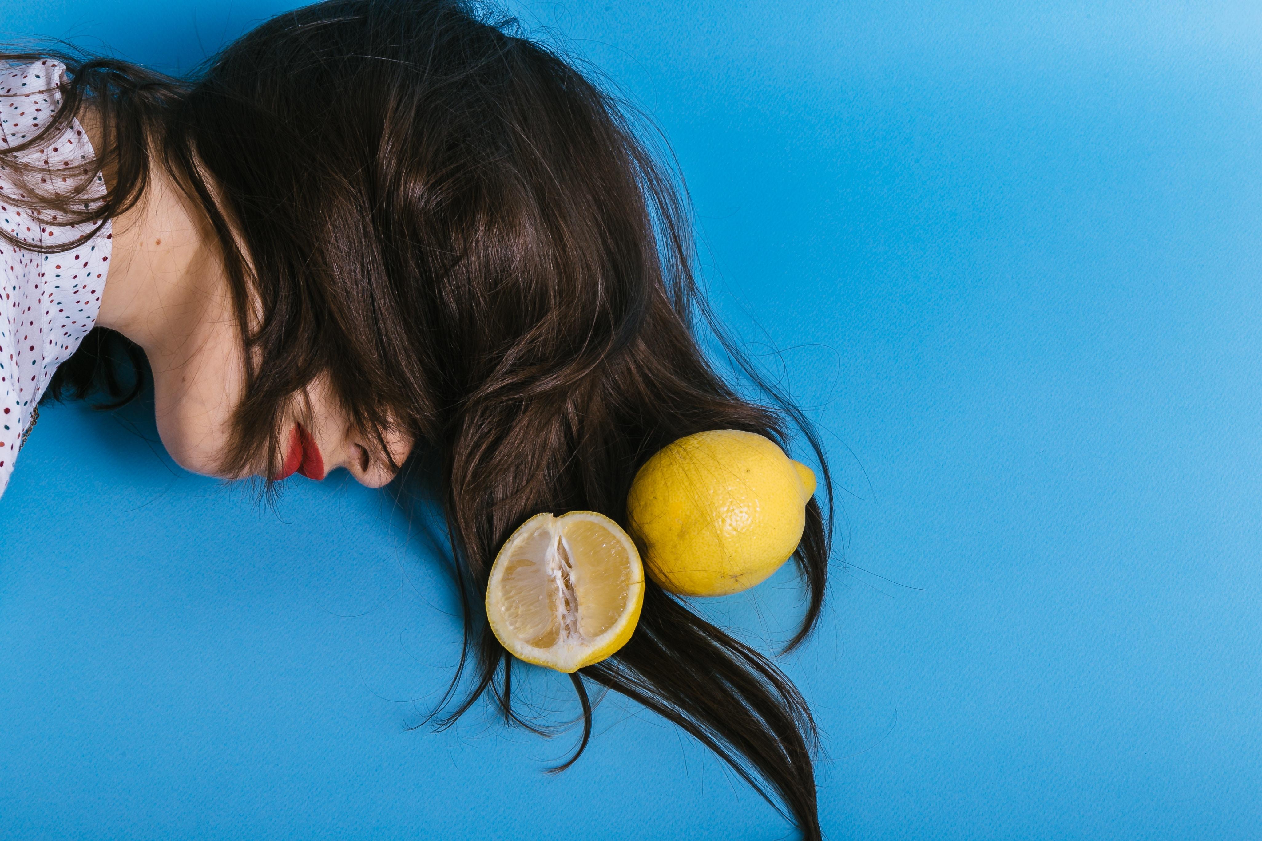 woman's head beside lemon