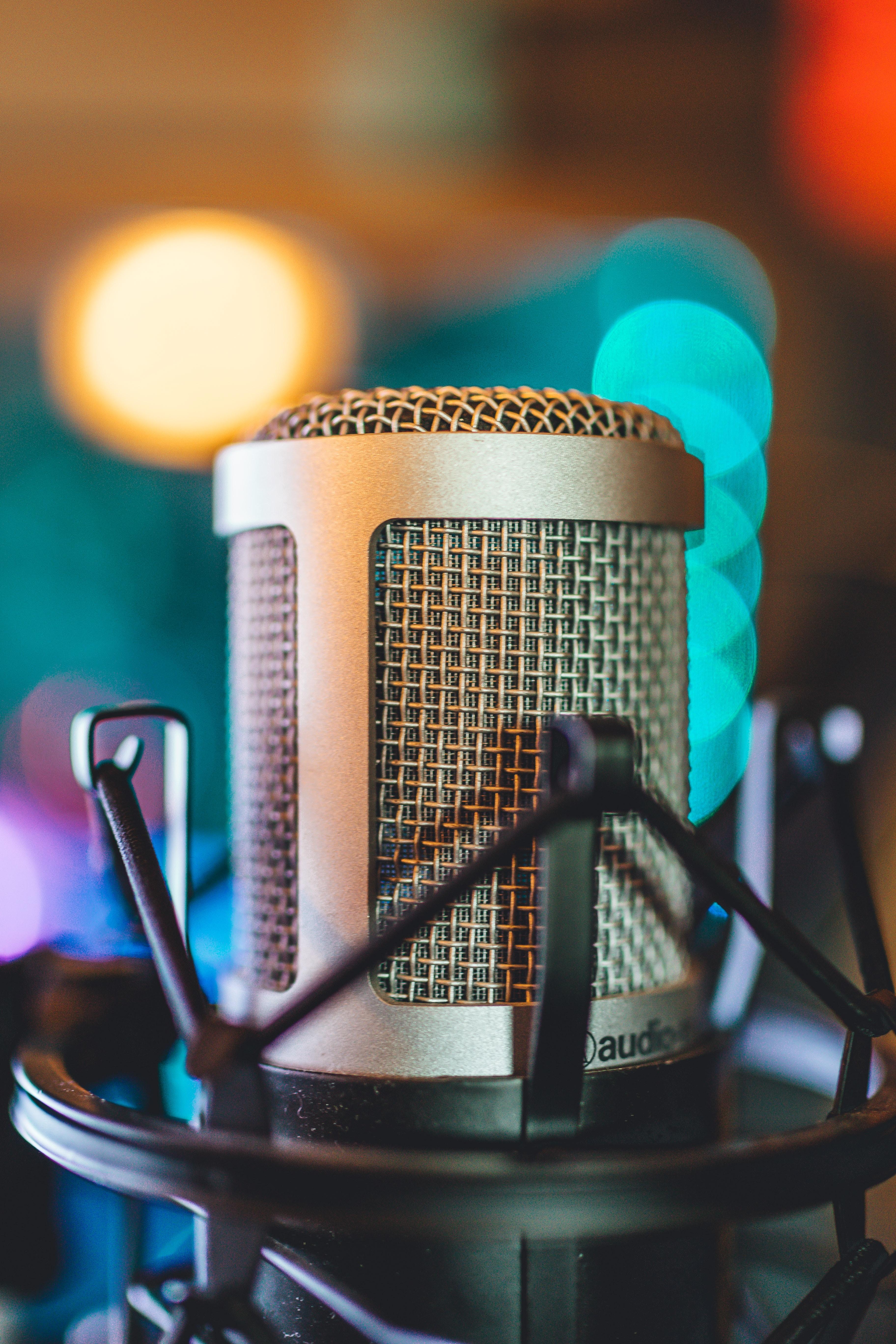 bokeh photo of gray Audio-Technica condenser microphone