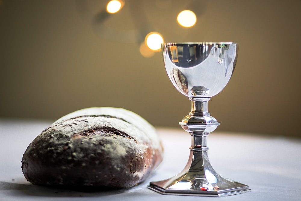 gray stainless steel chalice and bread bun