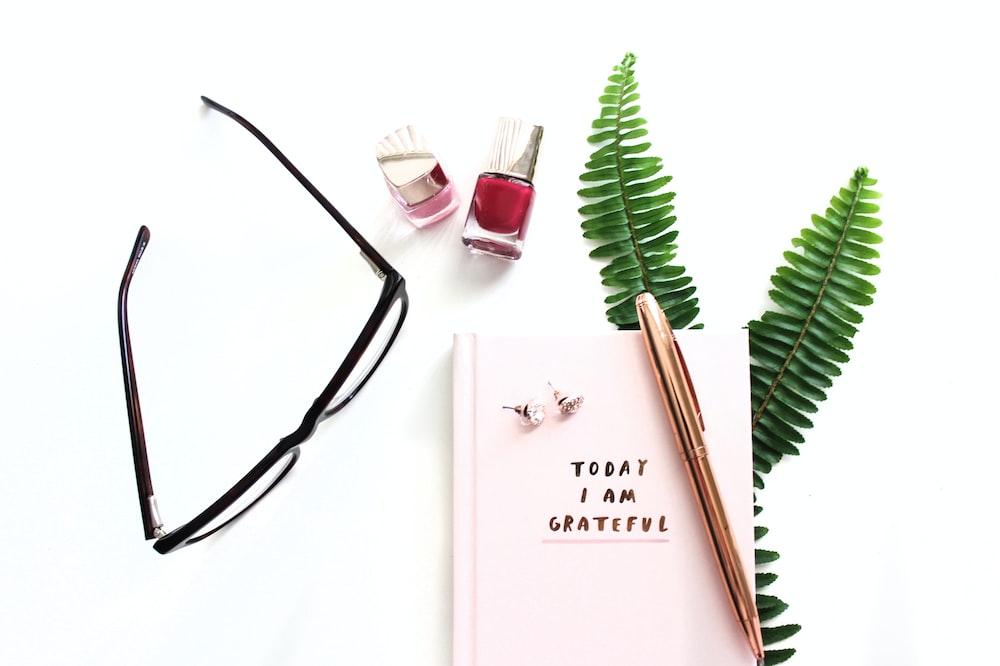 eyeglasses and cosmetic bottle
