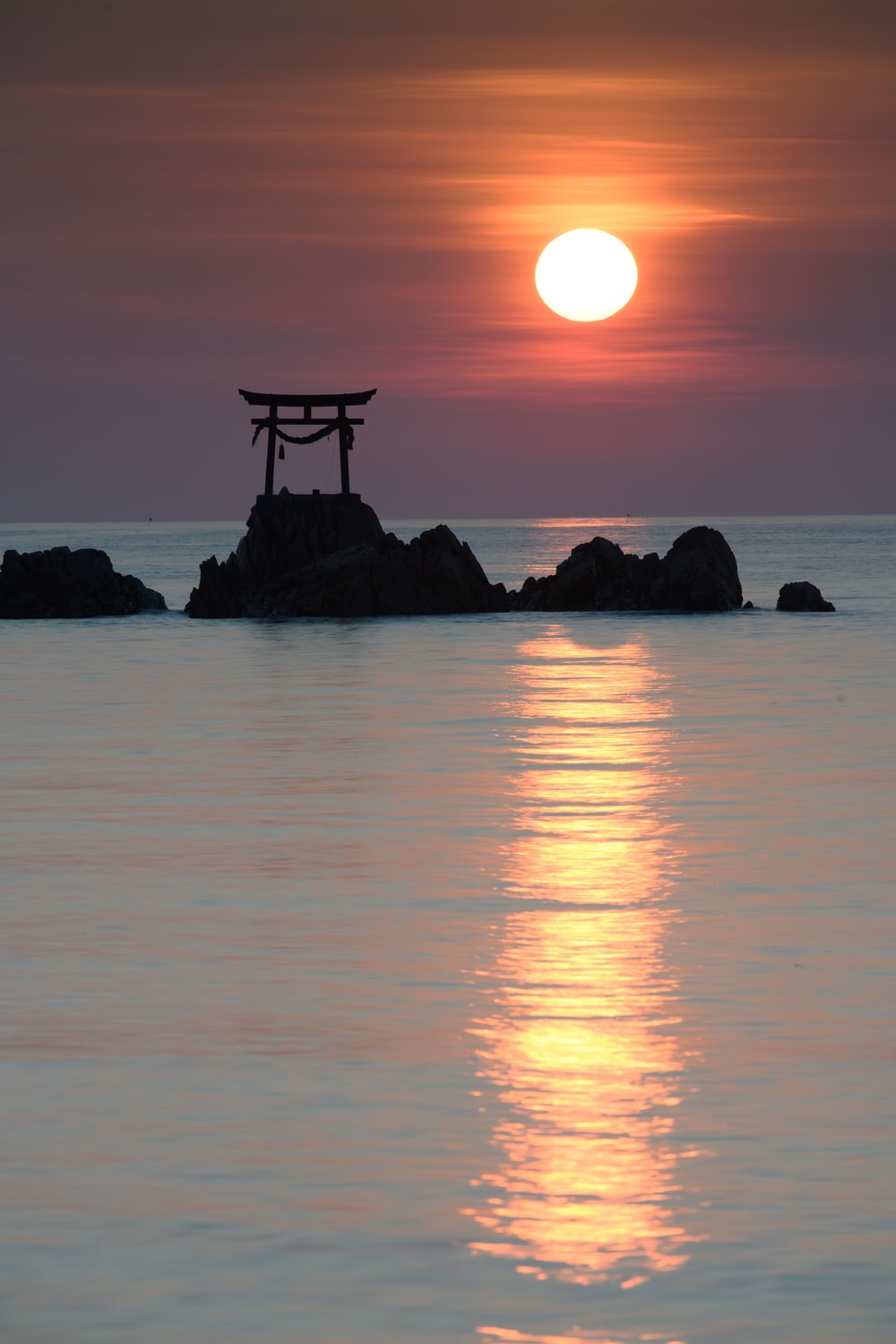 Itsukushima Shrine in middle of body of water