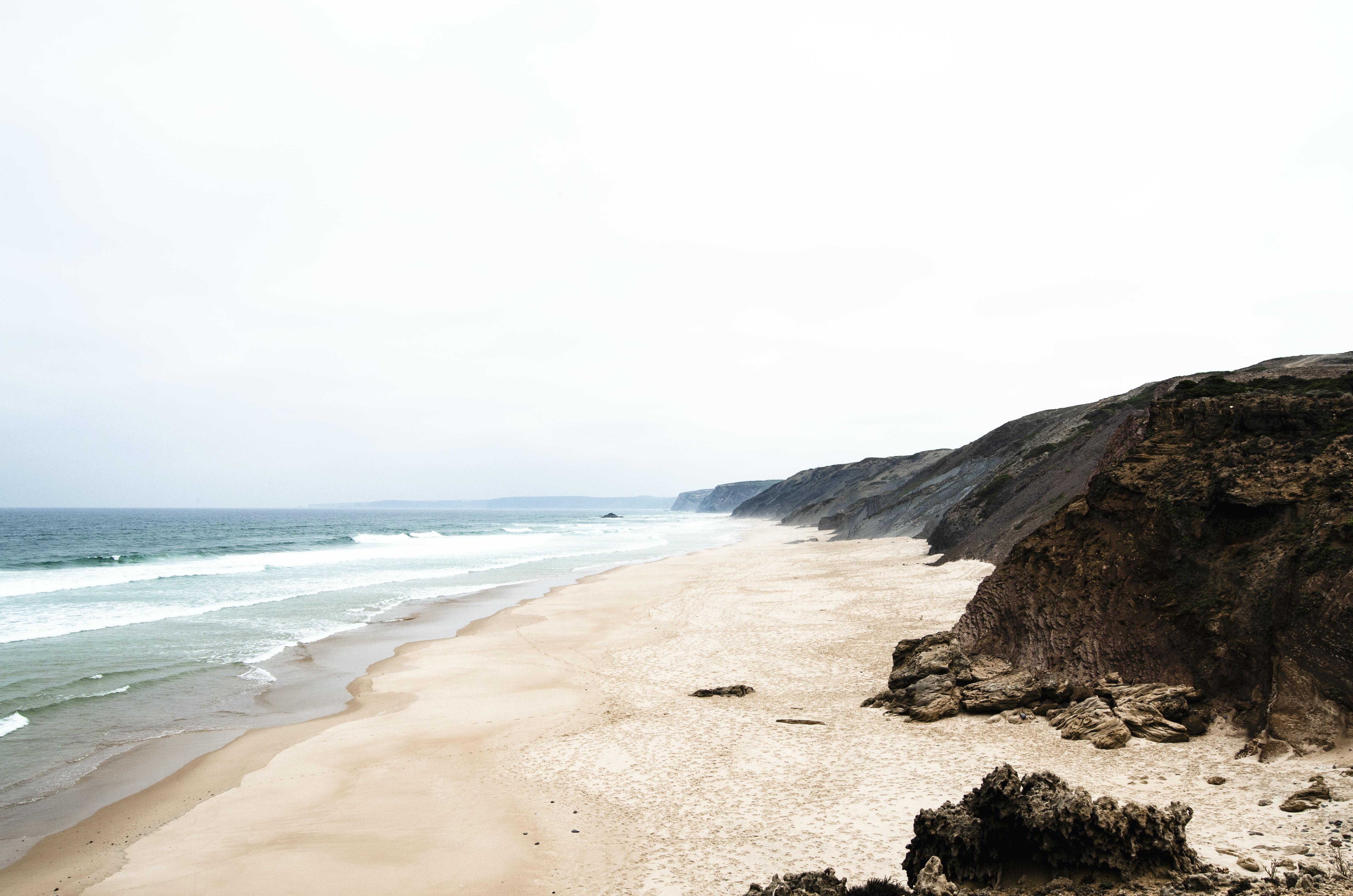 brown cliff near seashore