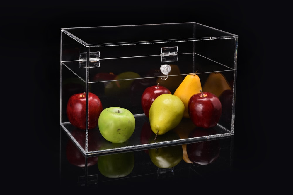 apple and pear in clear glass display