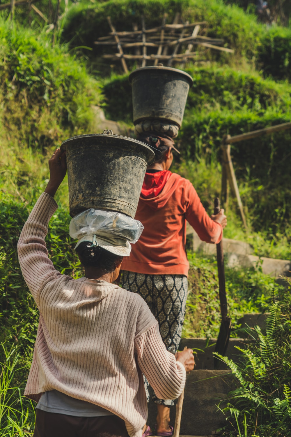 woman with buckets on heads