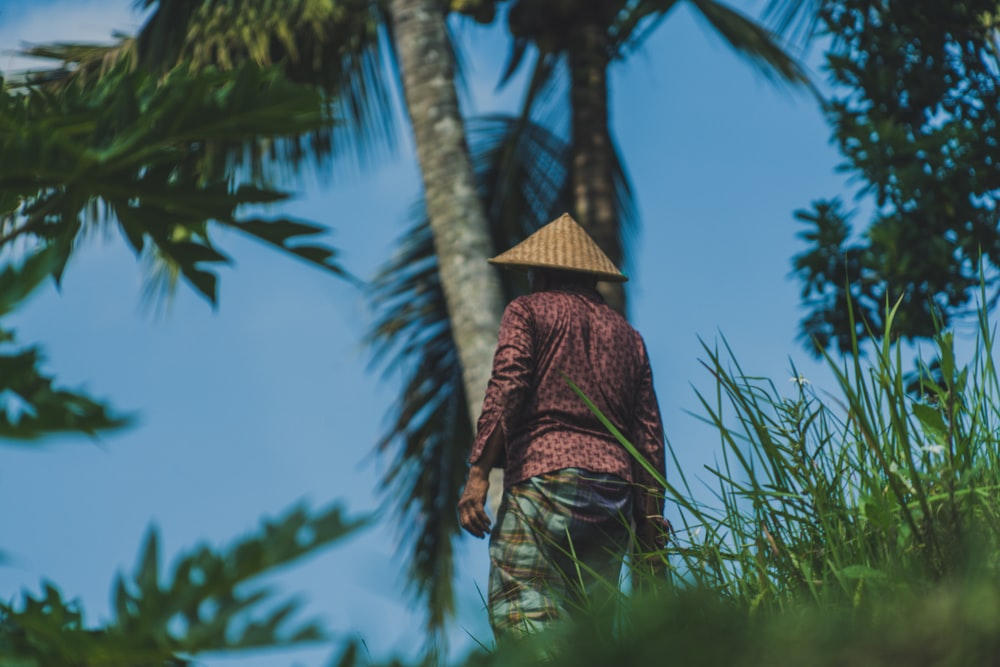 shallow focus photography of man wearing wicker hat