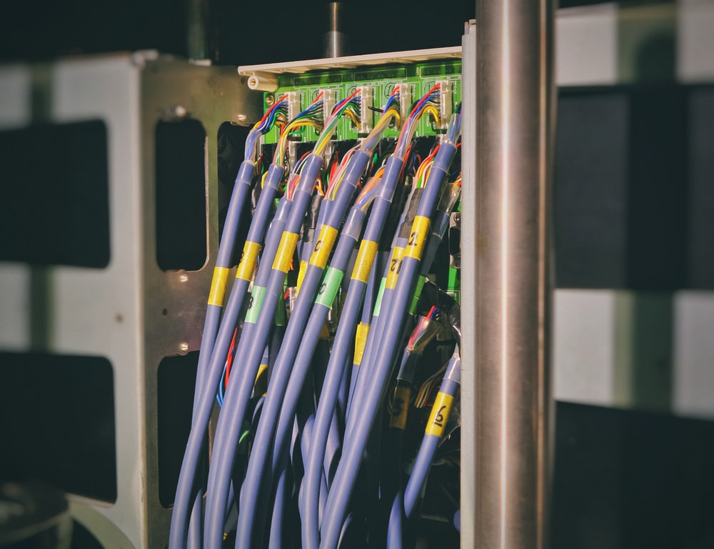 blue LAN cable plugged in green and black router