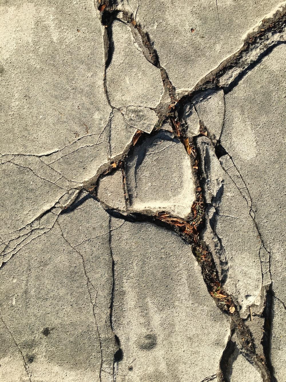 close-up photo of broken concrete wall