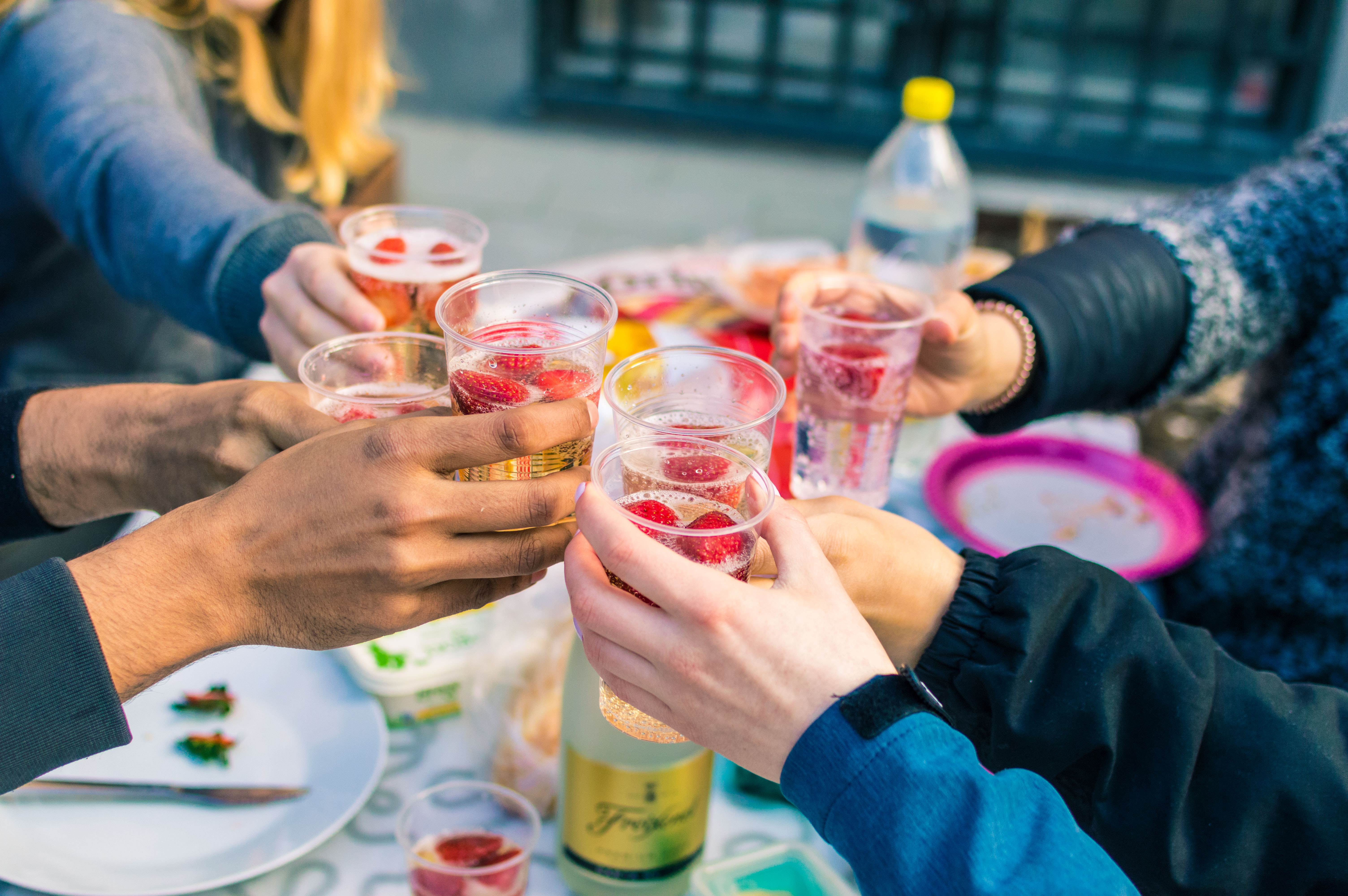 people holding clear drinking glasses