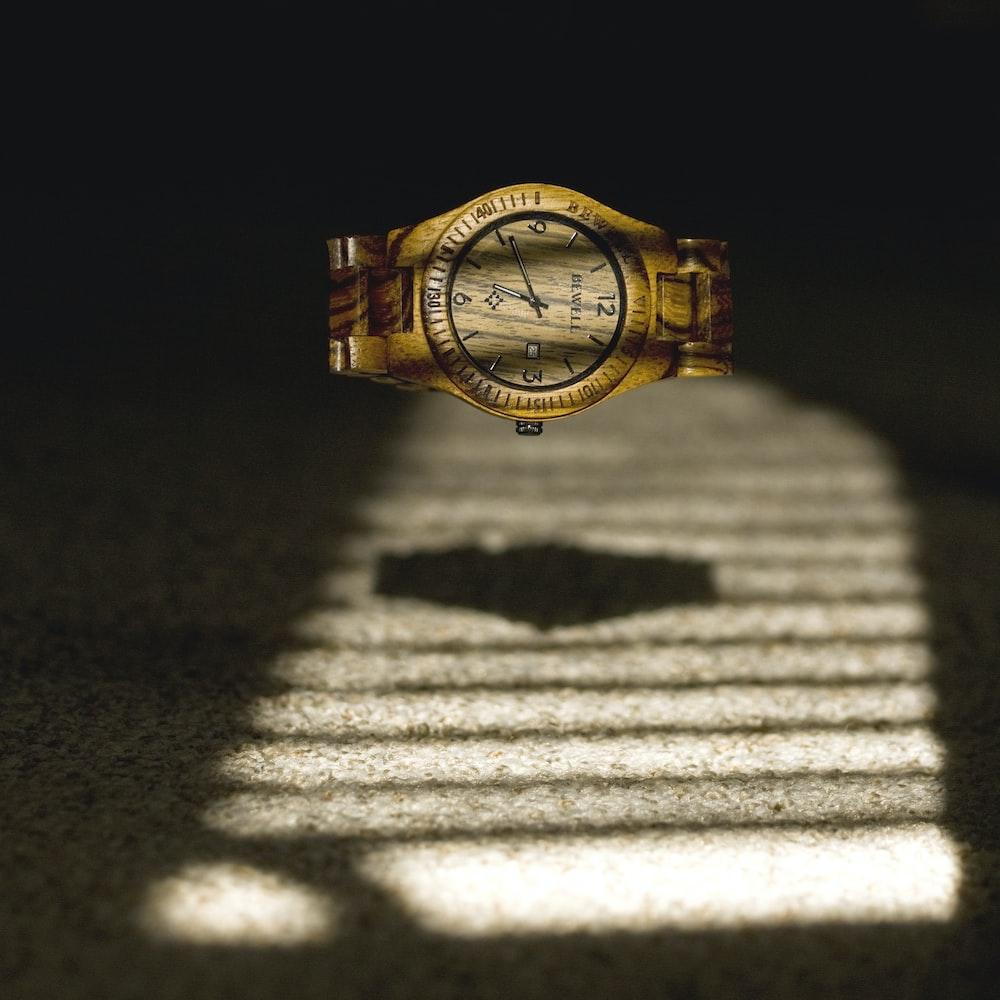 analog watch reading 6:42