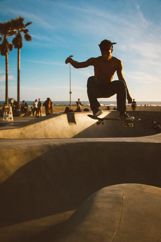 man doing tricks on skateboard on skateboard rail