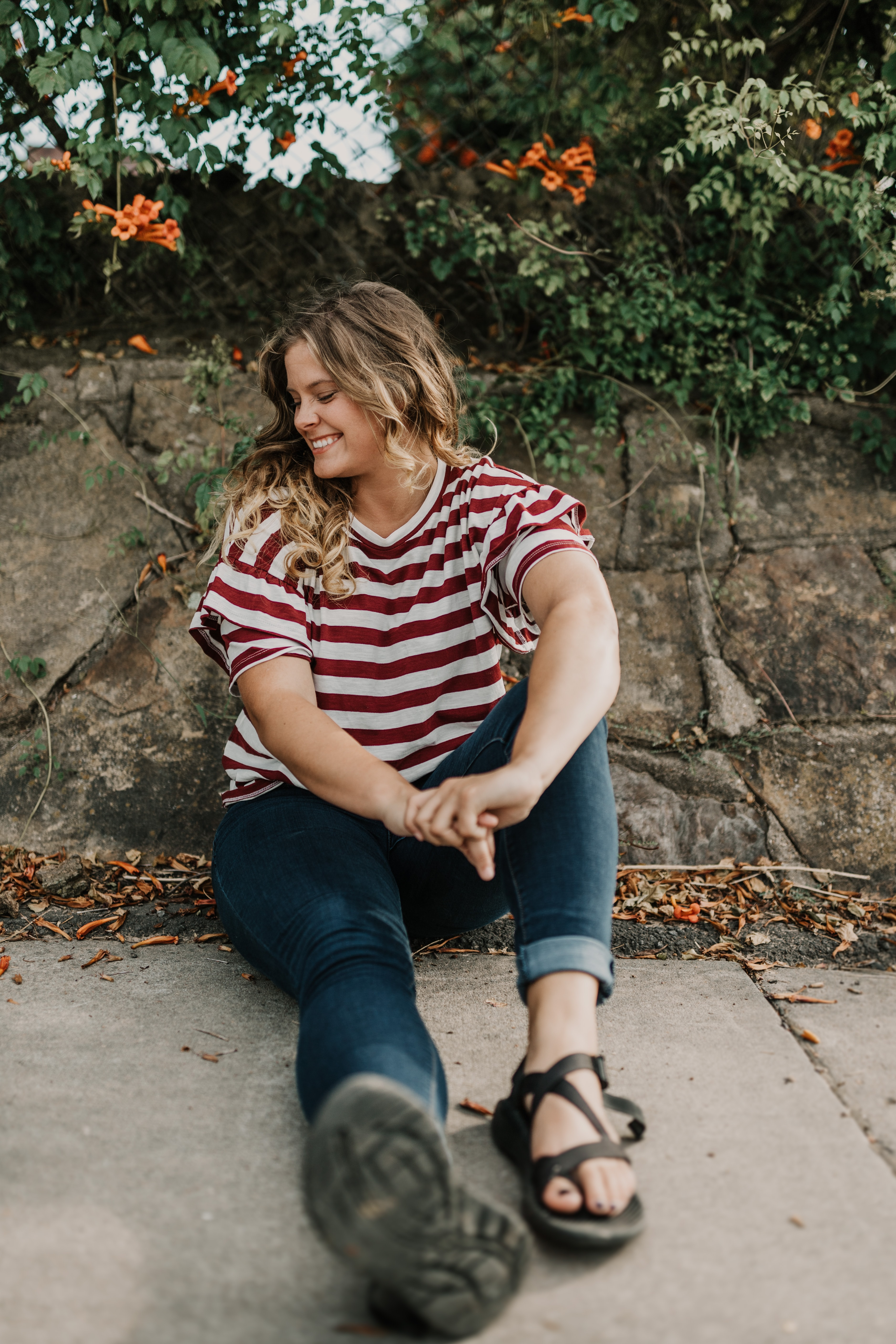 woman sitting on floor beside wall