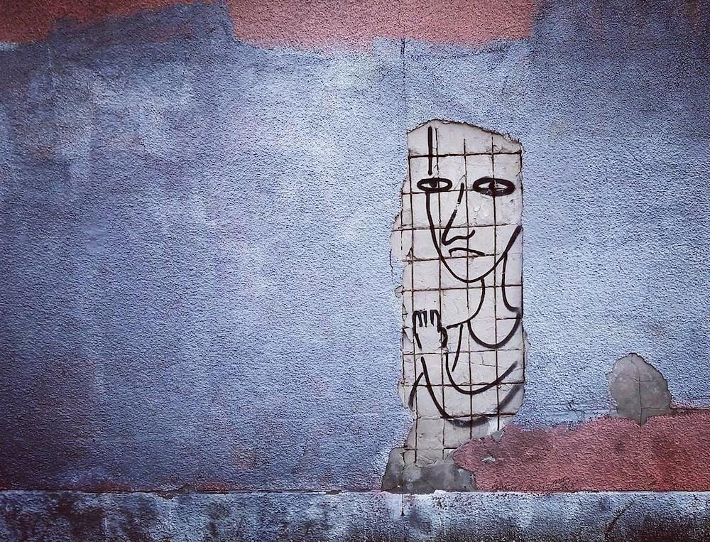 Man Sketch Near Blue Rug