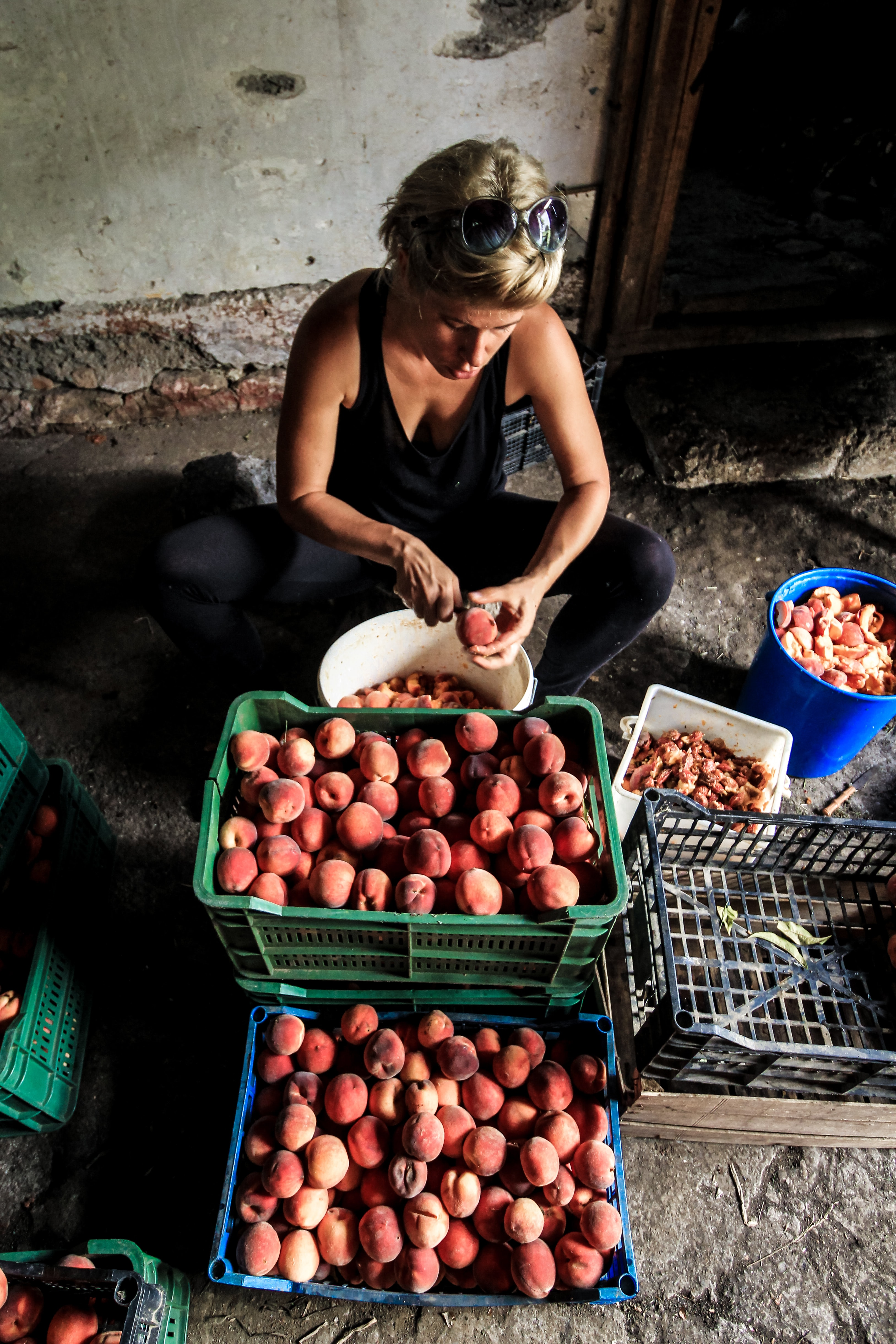 woman peeling fruits