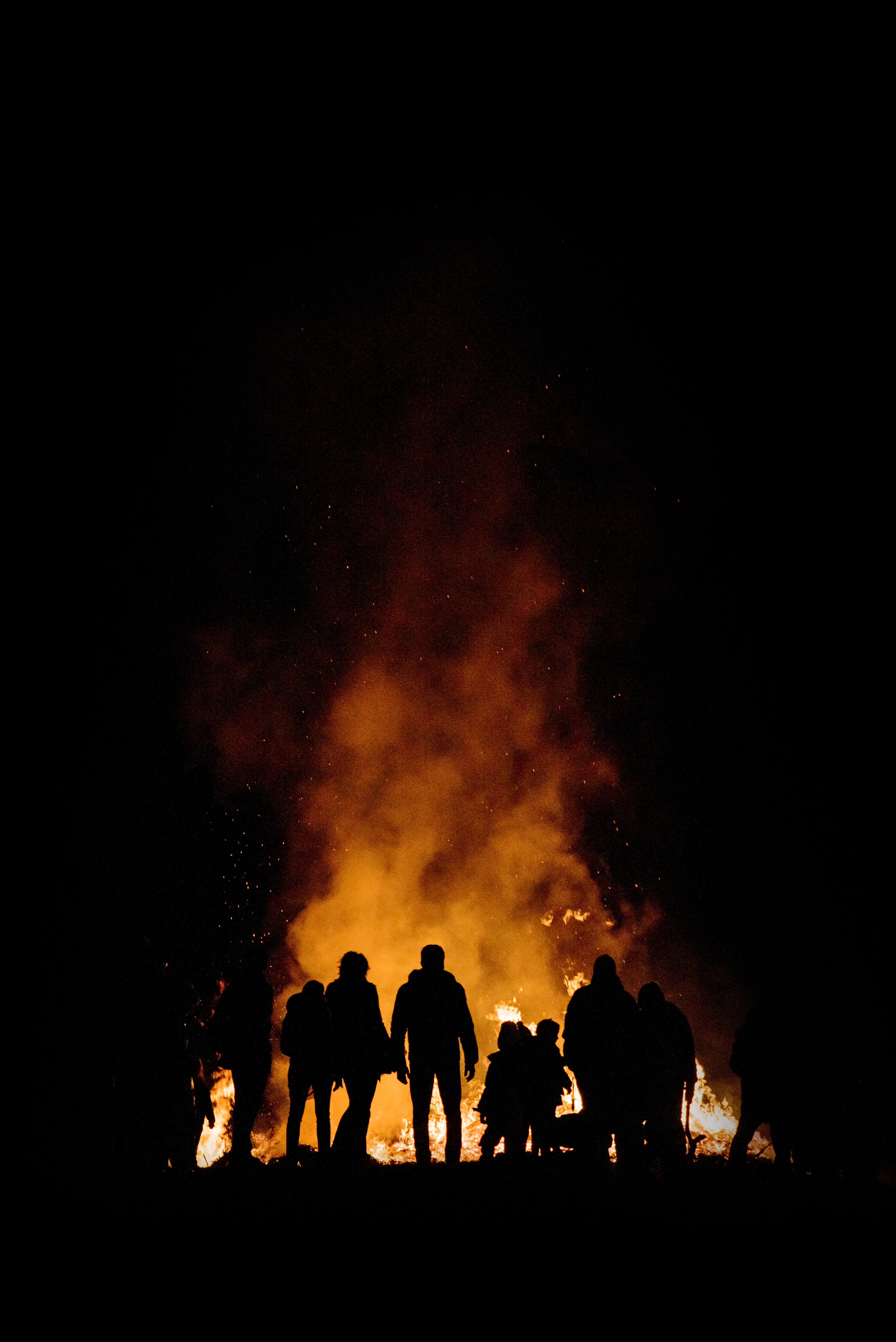bonfire surrounded by people