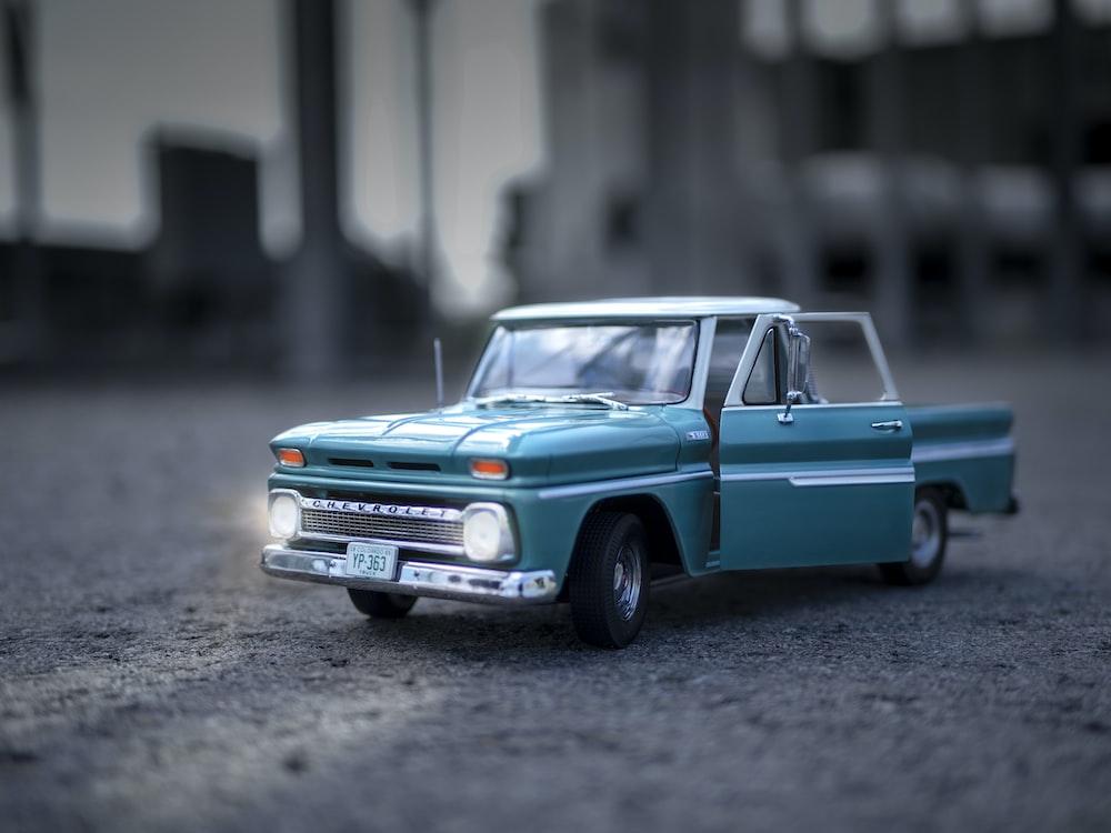 blue open door pickup truck