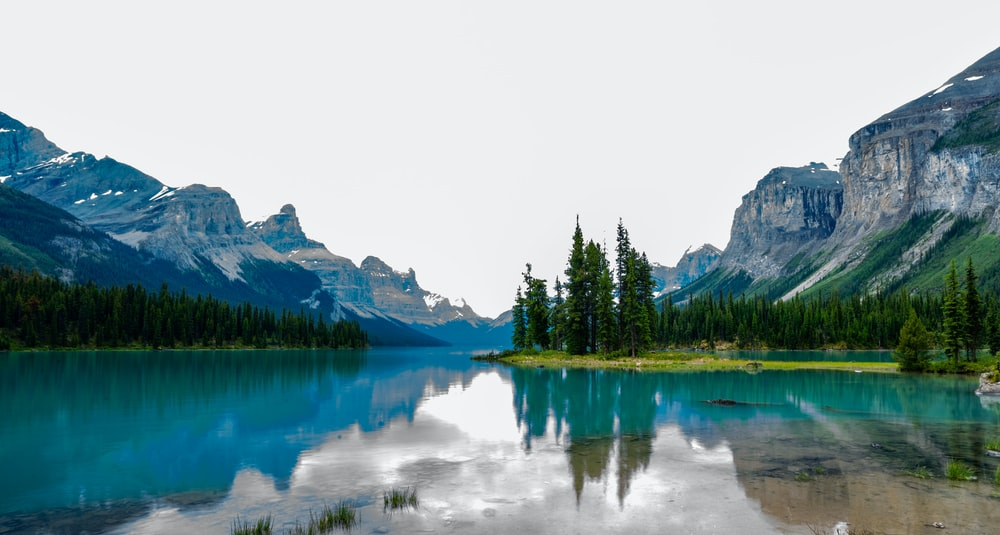 landmark photography of body of water and mountains