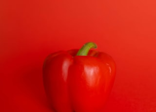 red bell pepper on red surface