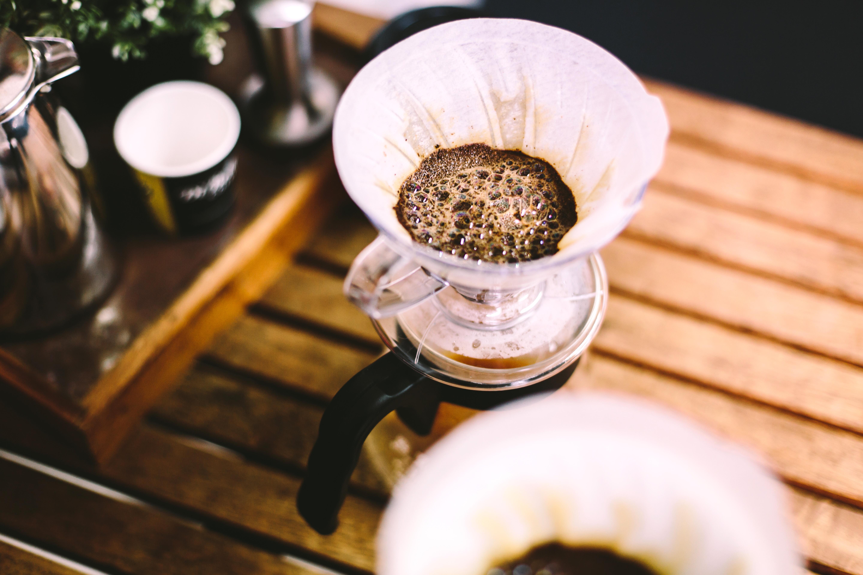 shallow focus photo coffee decanter