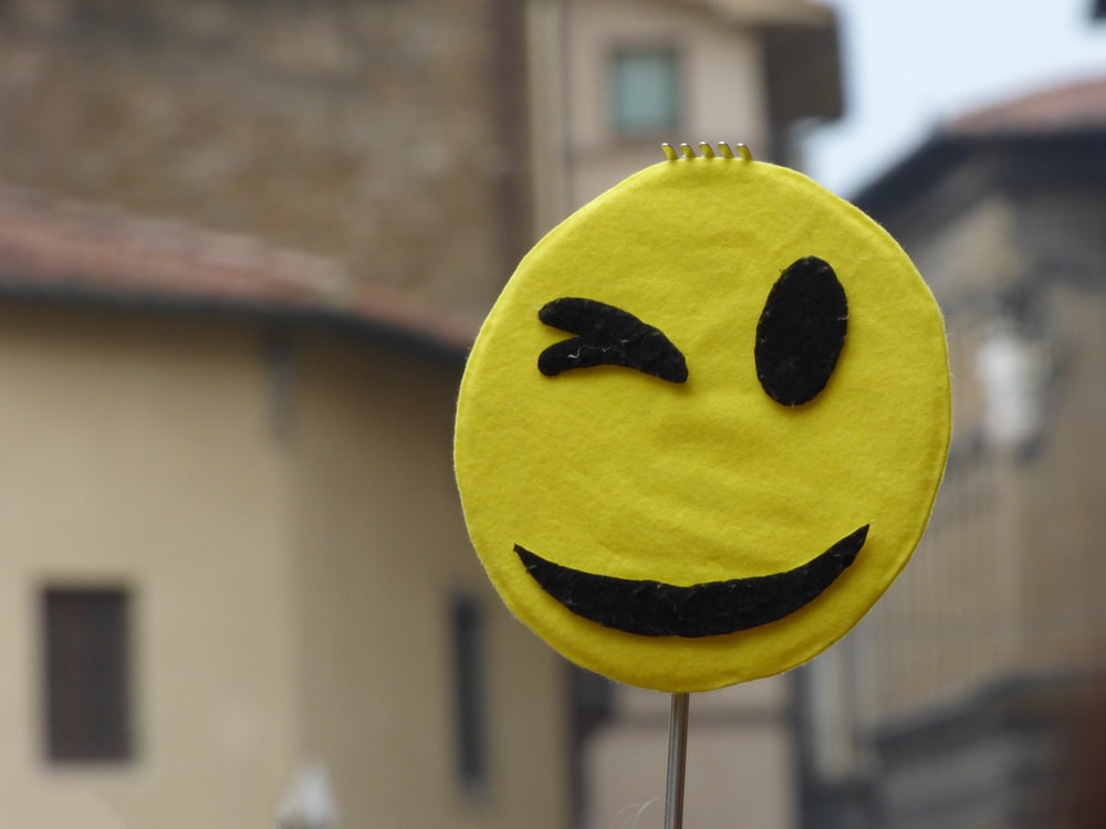shallow focus photography of yellow emoji