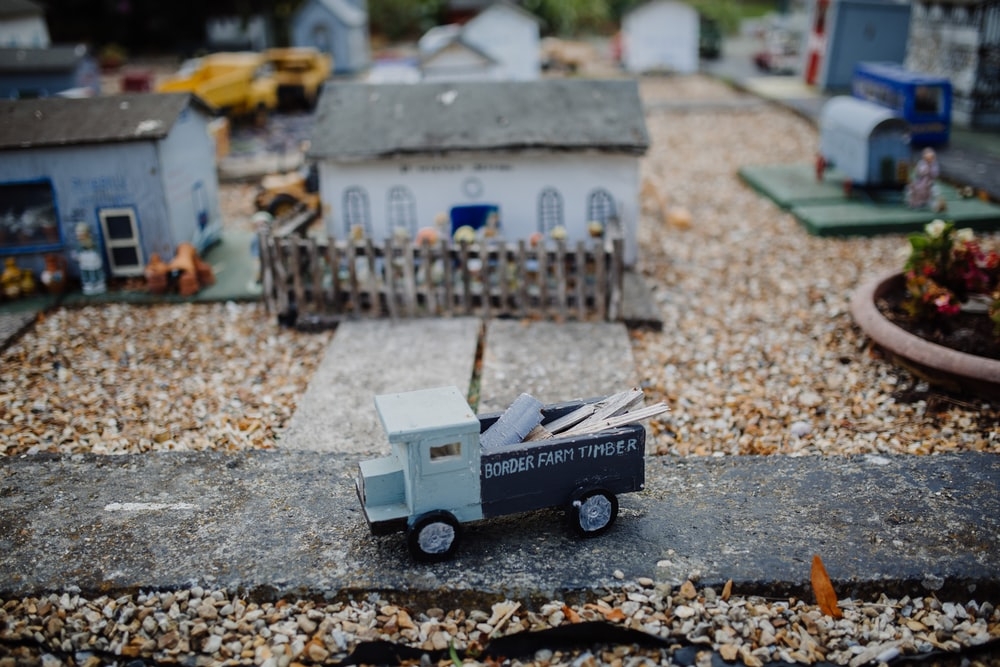 macro shot photography of miniature house and car
