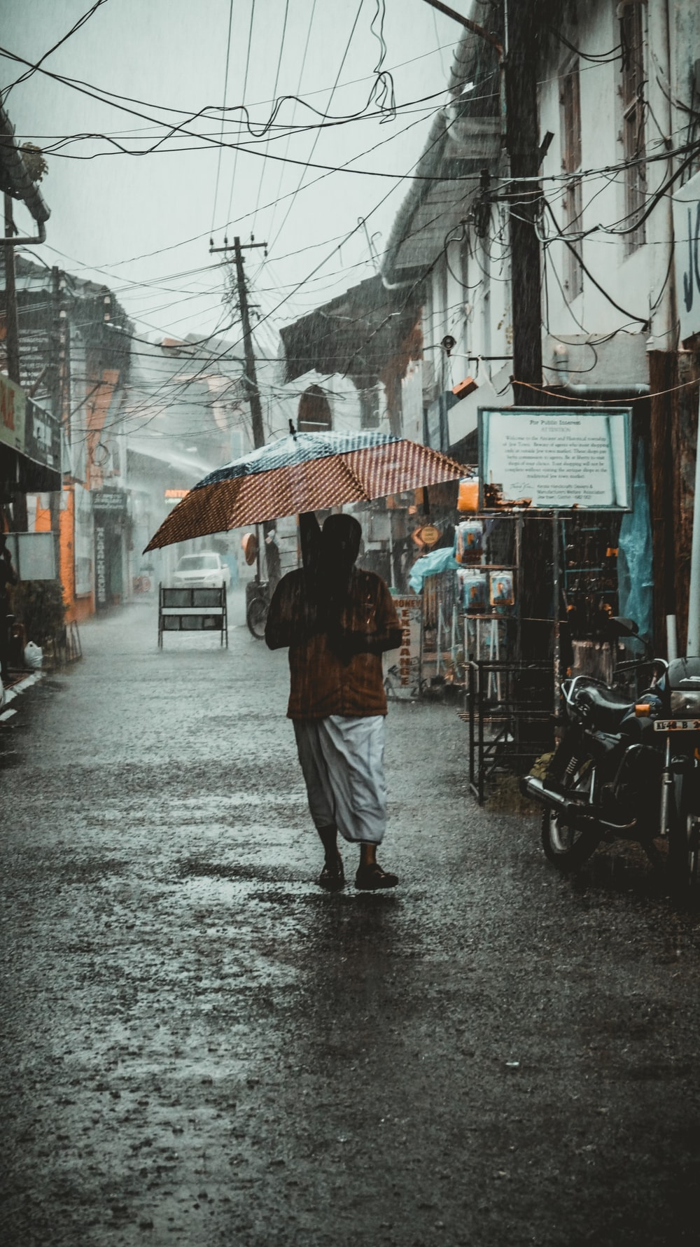 woman using umbrella under rain